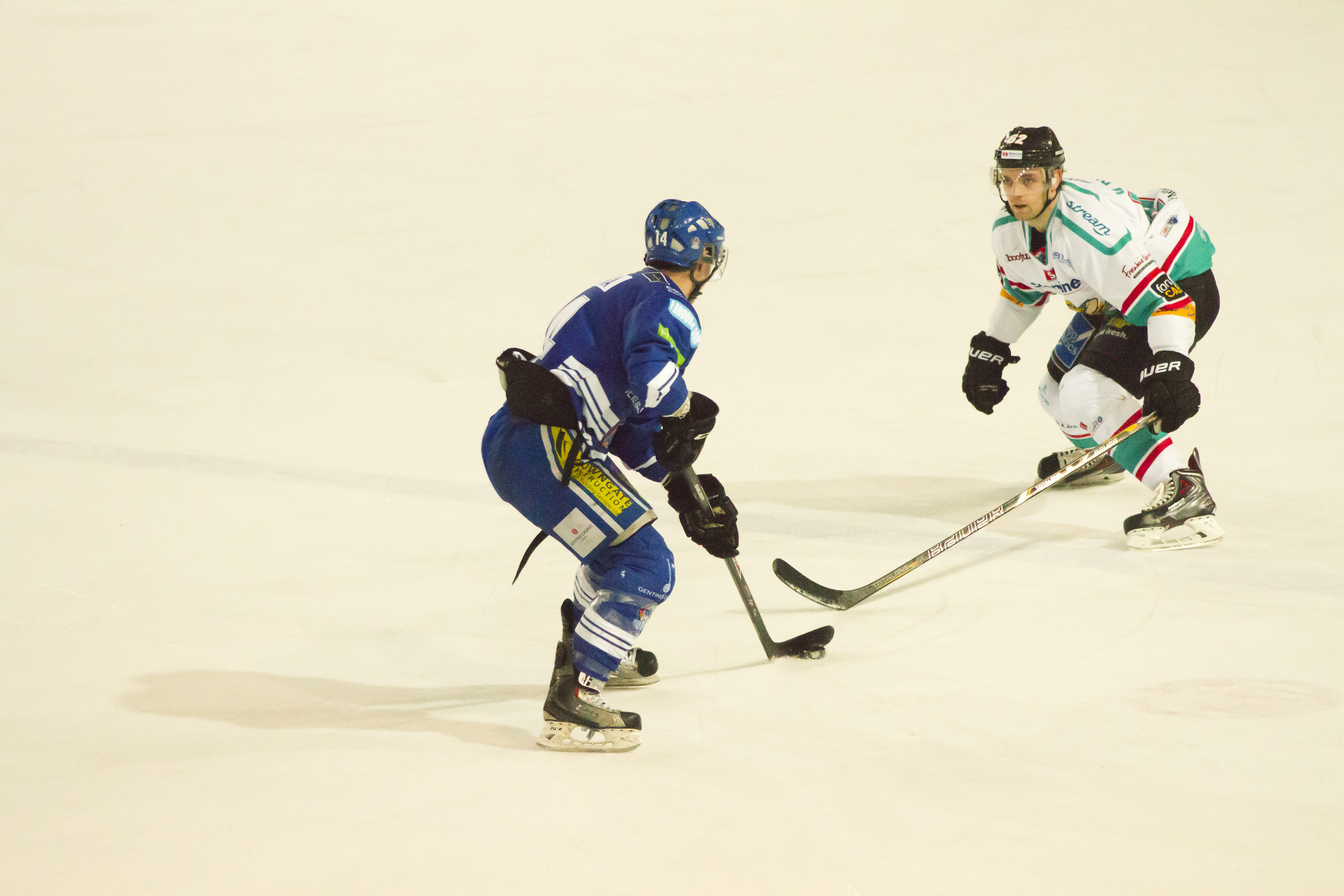 In such a fast-paced sport like ice hockey, sometimes it is easy to miss those moments when there is a pause in play. This moment shows a stand-off between two of the opposing players, which lasted hundredths of seconds.