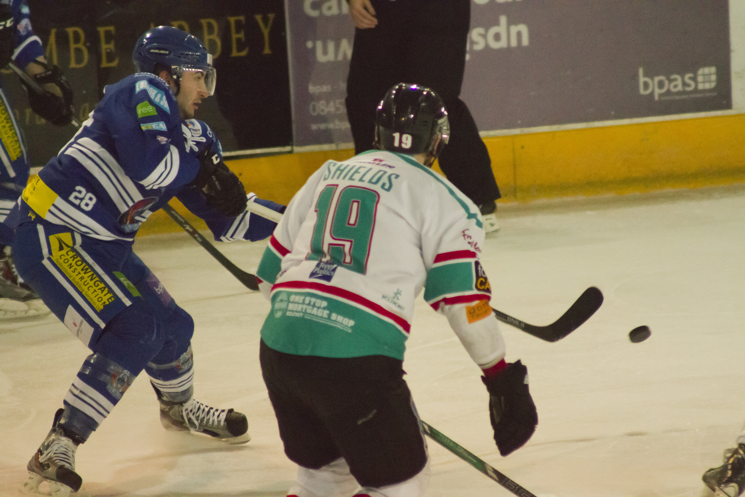 Again the moment here is having the puck in shot, with the Coventry Blaze player (blue) seen to have just released it to go up the rink.