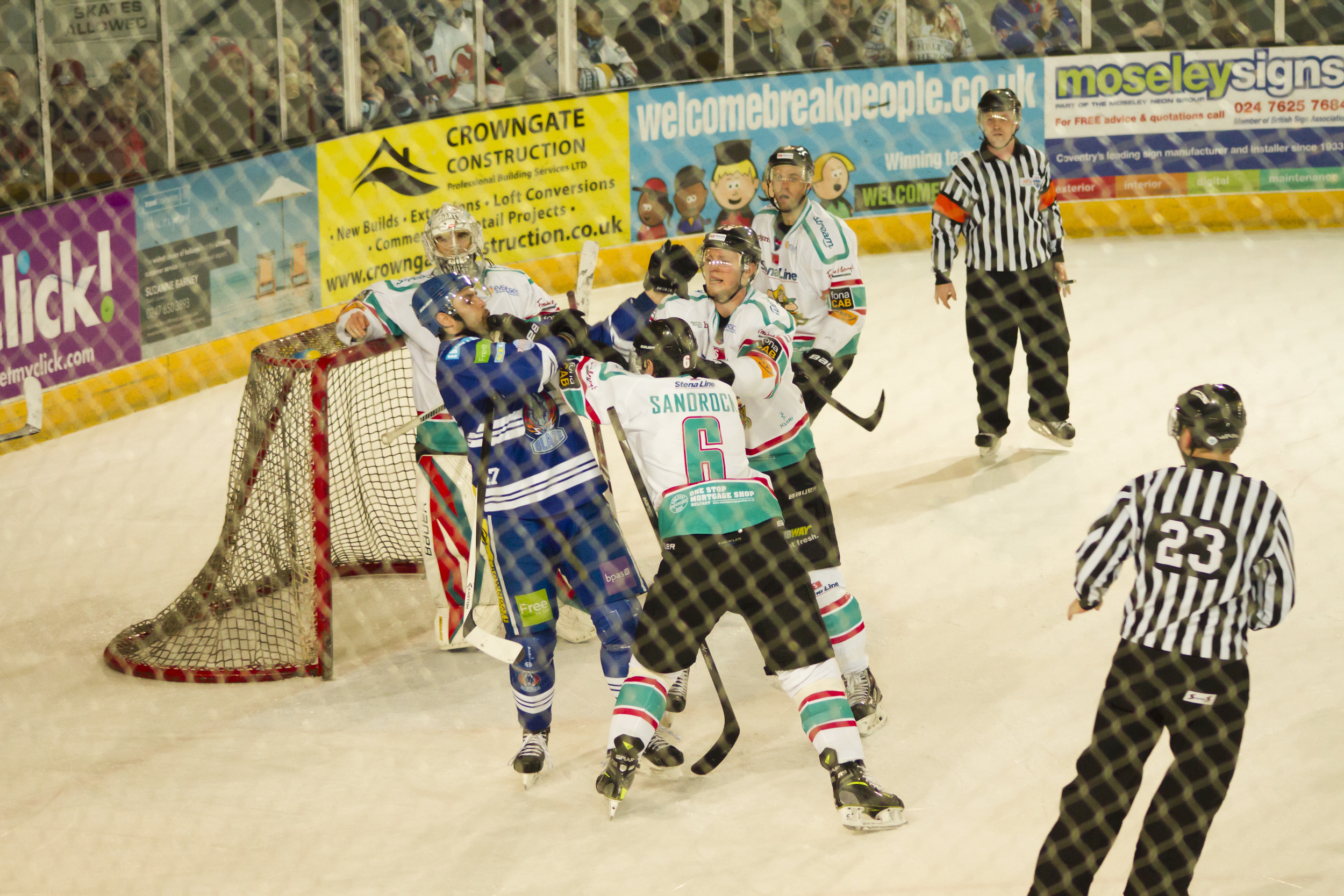 As with lots of sporting events, there are often off-the-ball / puck moments which can easily be missed, but can be the most newsworthy items that need illustrating. The frenetic pace of ice hockey can create hot-headed instances when players lash out at each other. In this image the Belfast Giants (white) player's fist is in contact with his Coventry Blaze (blue) opponent.