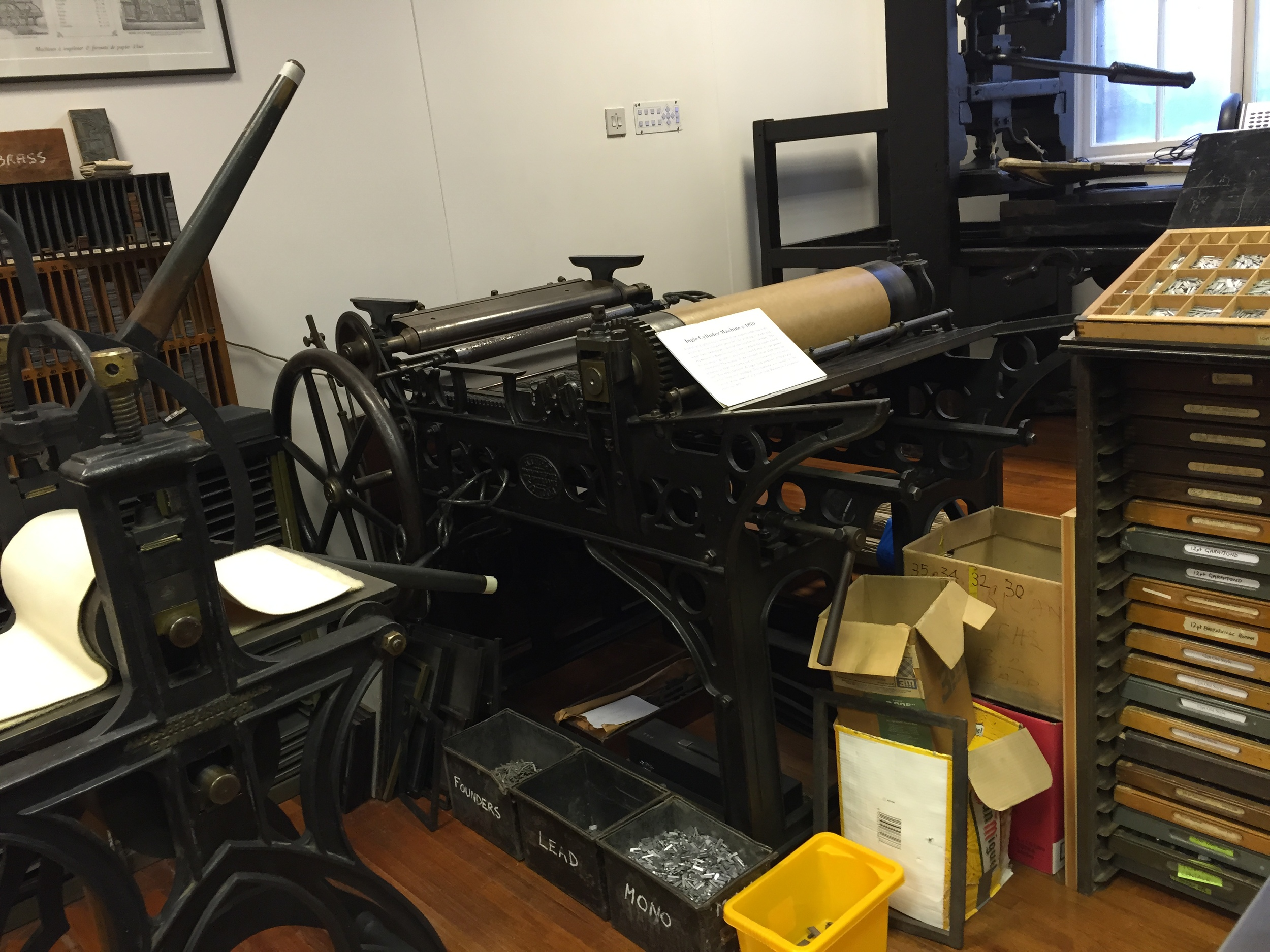 In the basement were loads of type and machines.