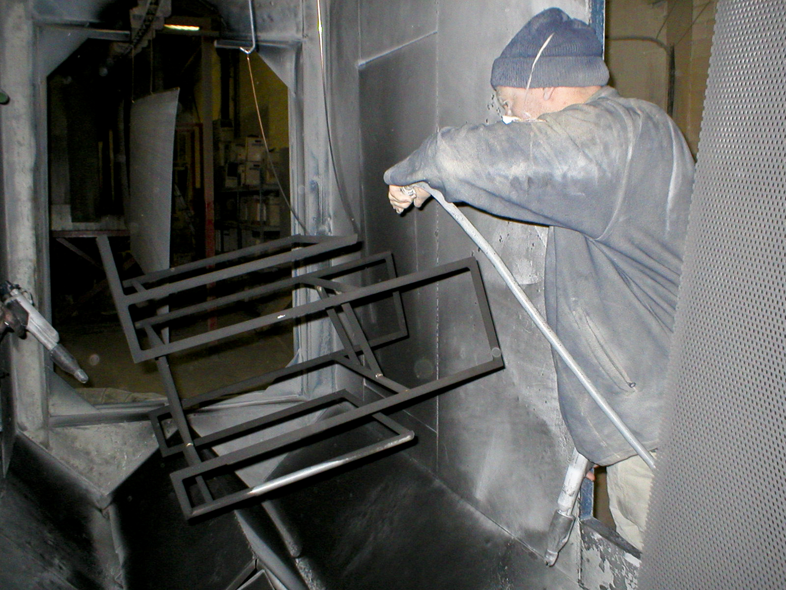 Frame in the process of being powder-coated