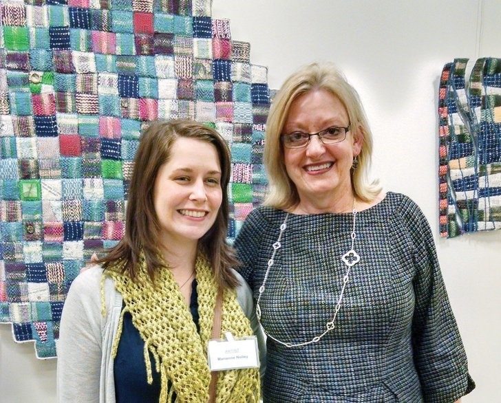 Deborah Kuster of Conway, right, professor of art at the University of Central Arkansas in Conway, seen with former student Marianne Nolley at the opening reception for Form in Fiber. Kuster and Nolley both have works in the show.