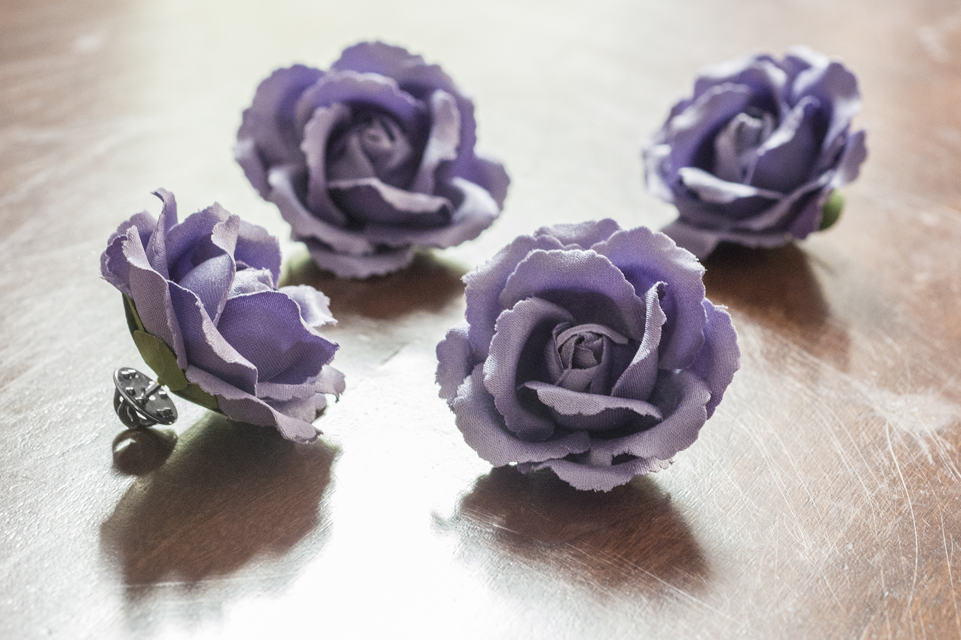 Custom lavender silk Fleurs in our cabbage rose silhouette for the groomsmen to match the bridesmaids