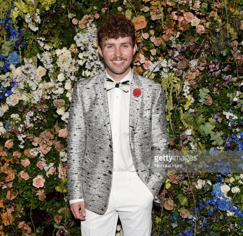 Timo Weiland attends The Frick Young Fellows Ball 2018 at The Frick Collection on March 15, 2018 in New York City wearing Fleur'd Pins.png