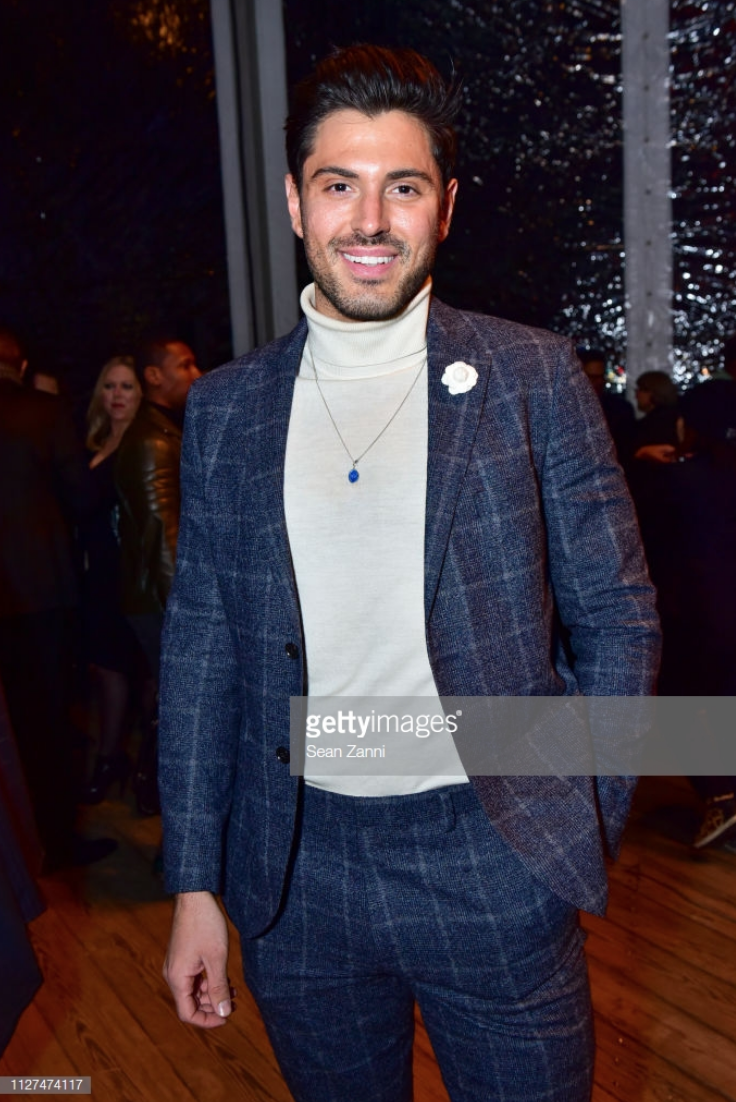 Joey Zauzig attends Joseph Abboud Men's FW19 Runway Show wearing Fleur'd Pins Winter White Cashmere Jerry Rose (Photo by Sean Zanni:Patrick McMullan via Getty Images).jpg