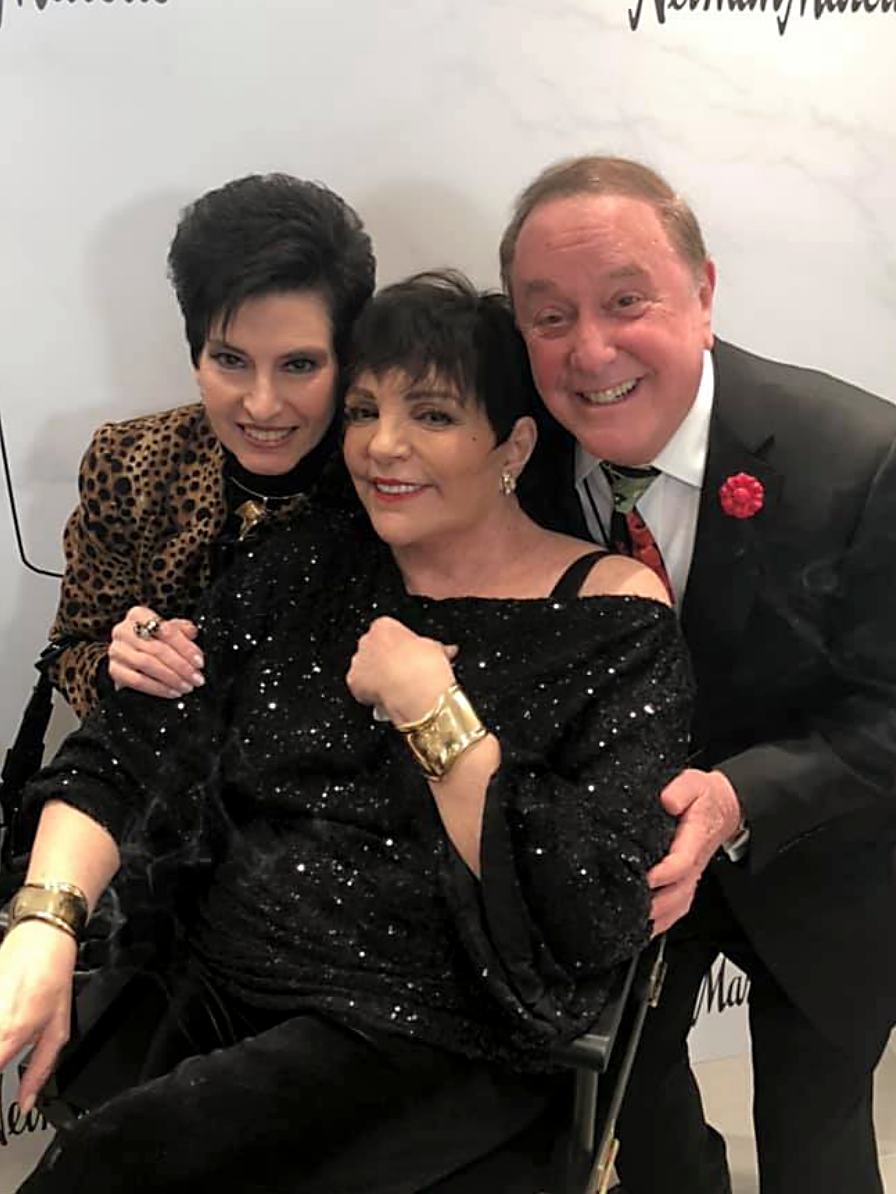 Producers Arlene and Allan Lazare, wearing Fleur'd Pins, attend the opening of Neiman Marcus at Hudson Yards with Liza Minnelli.png