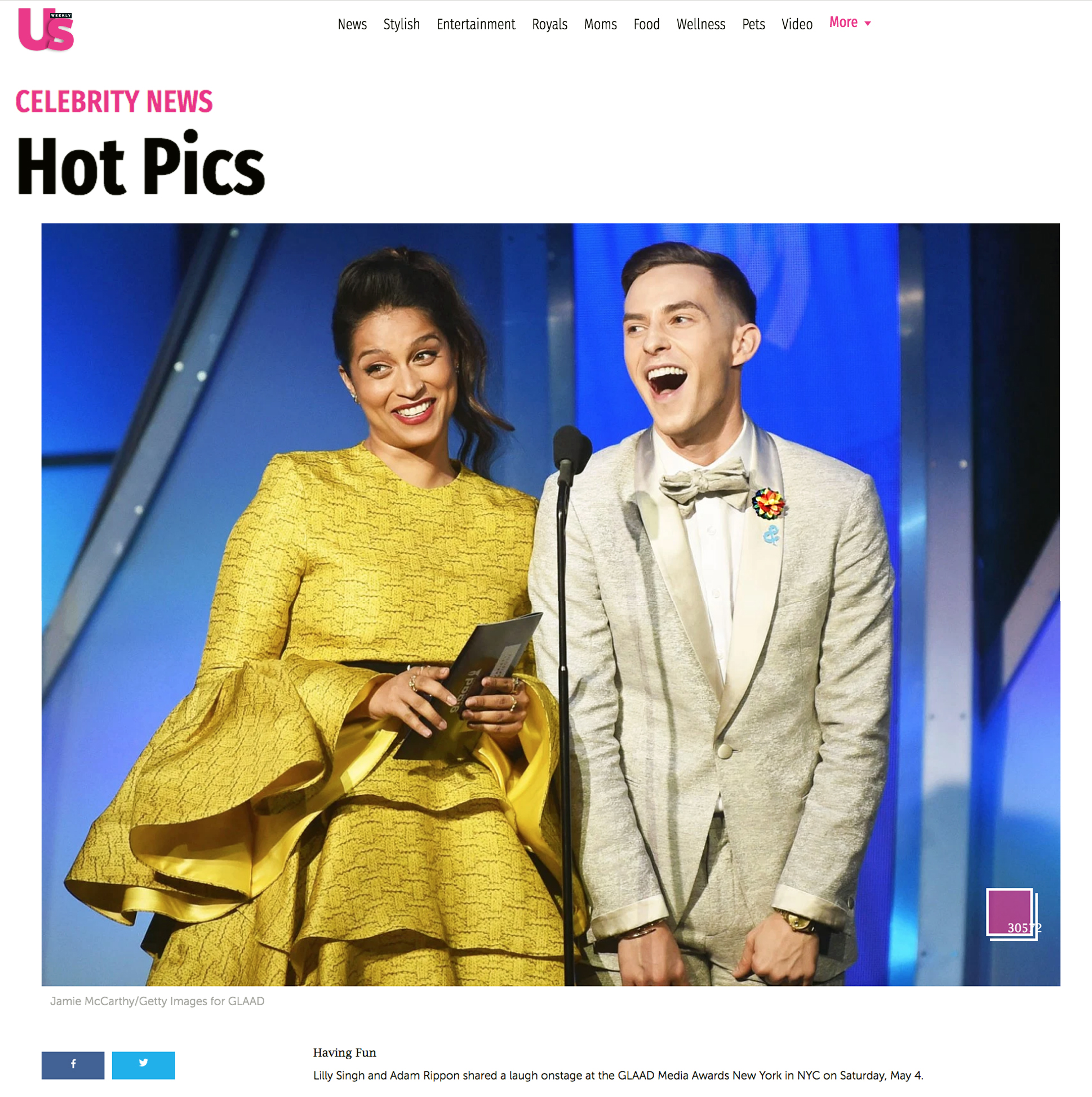 US Weekly - Lilly Singh (L) and Adam Rippon, wearing Fleur'd Pins PRIDE Satin Dahlia, speak onstage during the 30th Annual GLAAD Media Awards New York at New York Hilton Midtown on May 04, 2019 in New York City. Photo by Jamie McCarthy.jpg