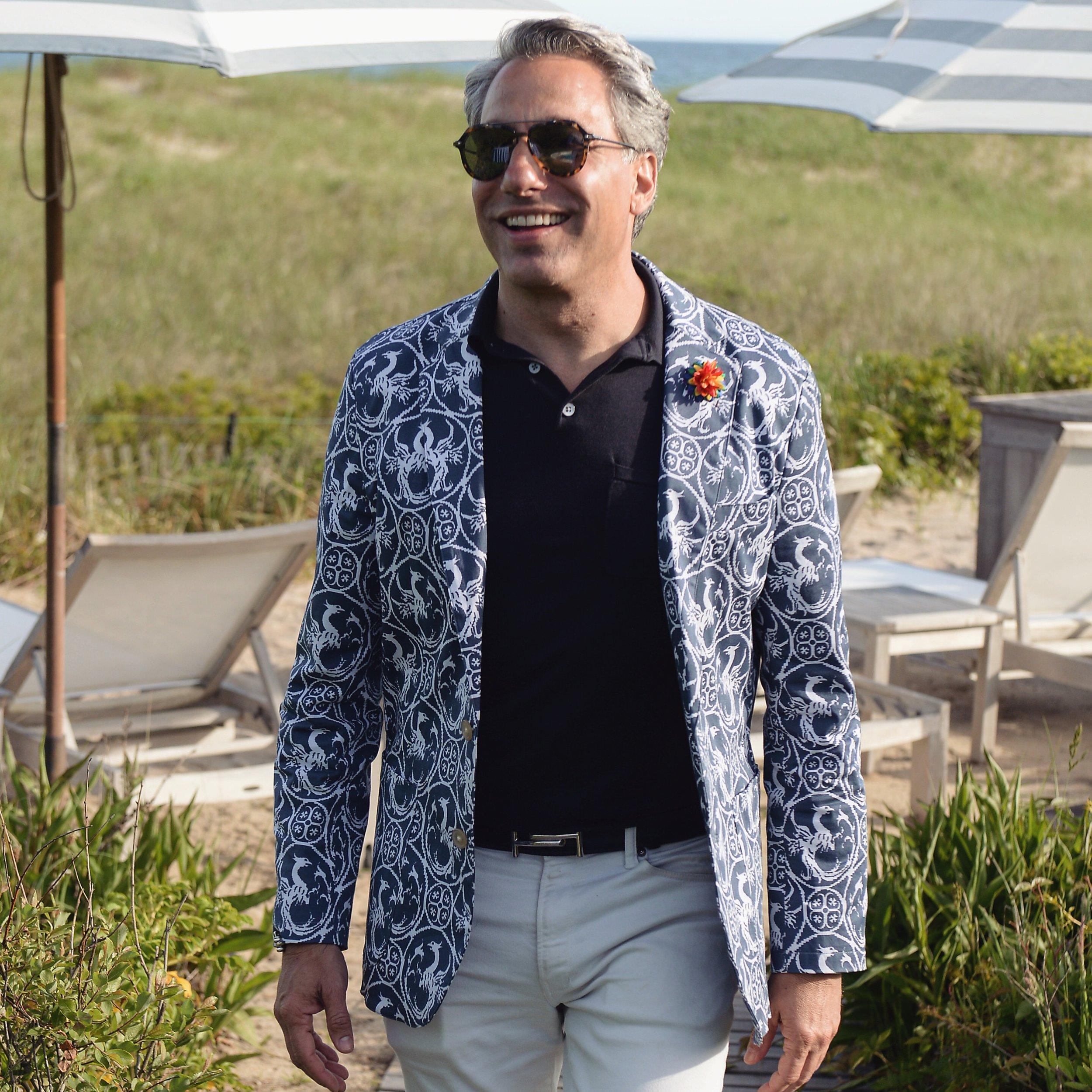 Queer Eye alumnus, interior designer and author, Thom Filicia wearing Fleur'd Pins' Pride Satin Dahlia in East Hampton.JPG