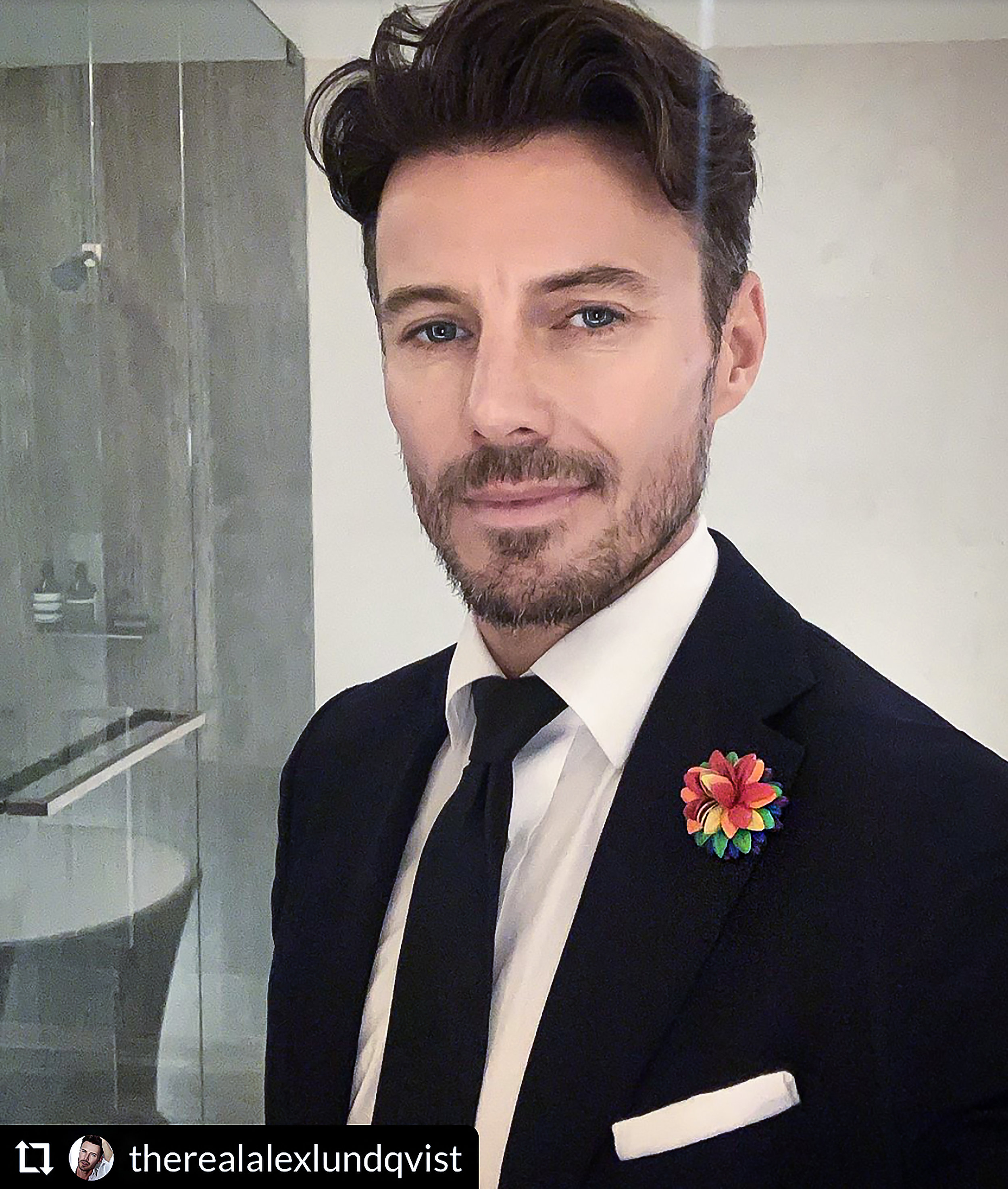 Alex Lundqvist wearing Fleur'd Pins Pride Leather Dahlia.jpg