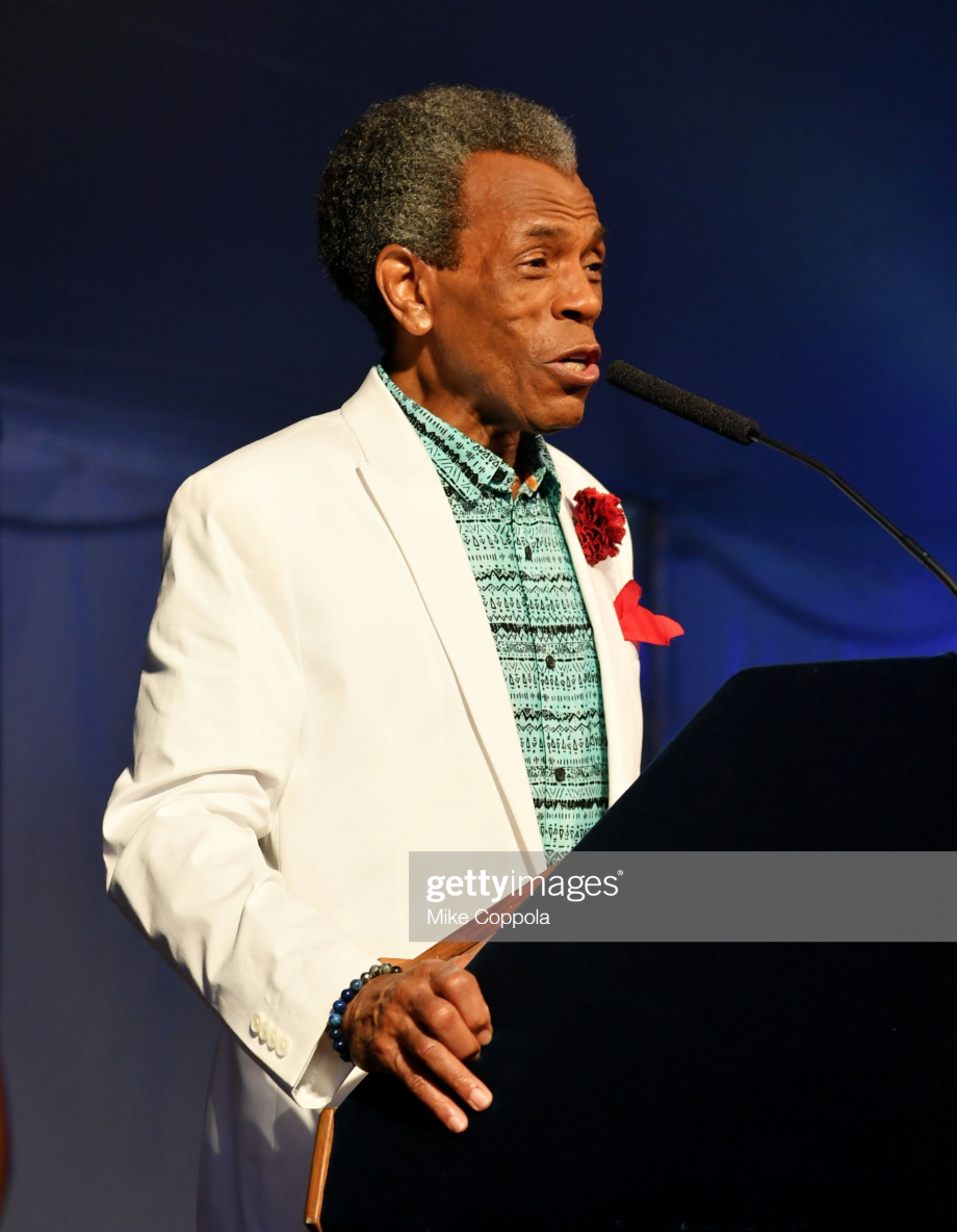 Andre De Shields accepts an award as Harlem, New York City And New York State honor Memphis' 200th Anniversary celebrating %22A New Century Of Soul%22 between two iconic communities at Gracie Mansion on July 18, 2019 in New York City wearing Fleur'd Pins.png