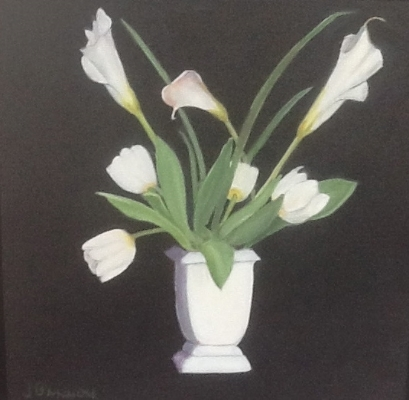 Oil on Canvas   This is a simple painting, framed in a black floater frame. The wonderful bright white tulips andlilies, tinged with a touch of pink, makeit the perfect picture to perk up the side of a door, a bathroom or just to make you smile as you walk by the corner and get a peek.