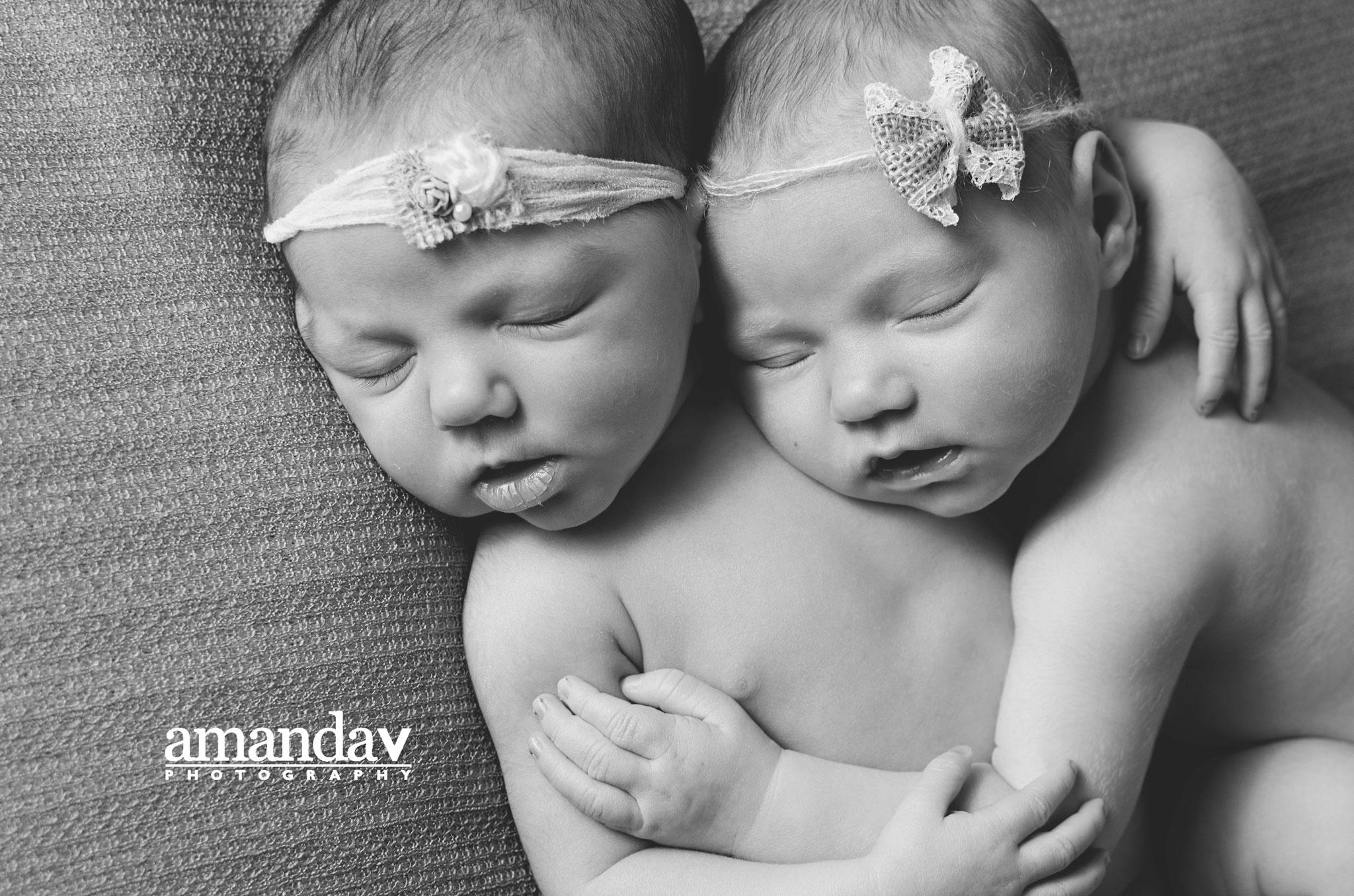 black and white image newborn twin girls
