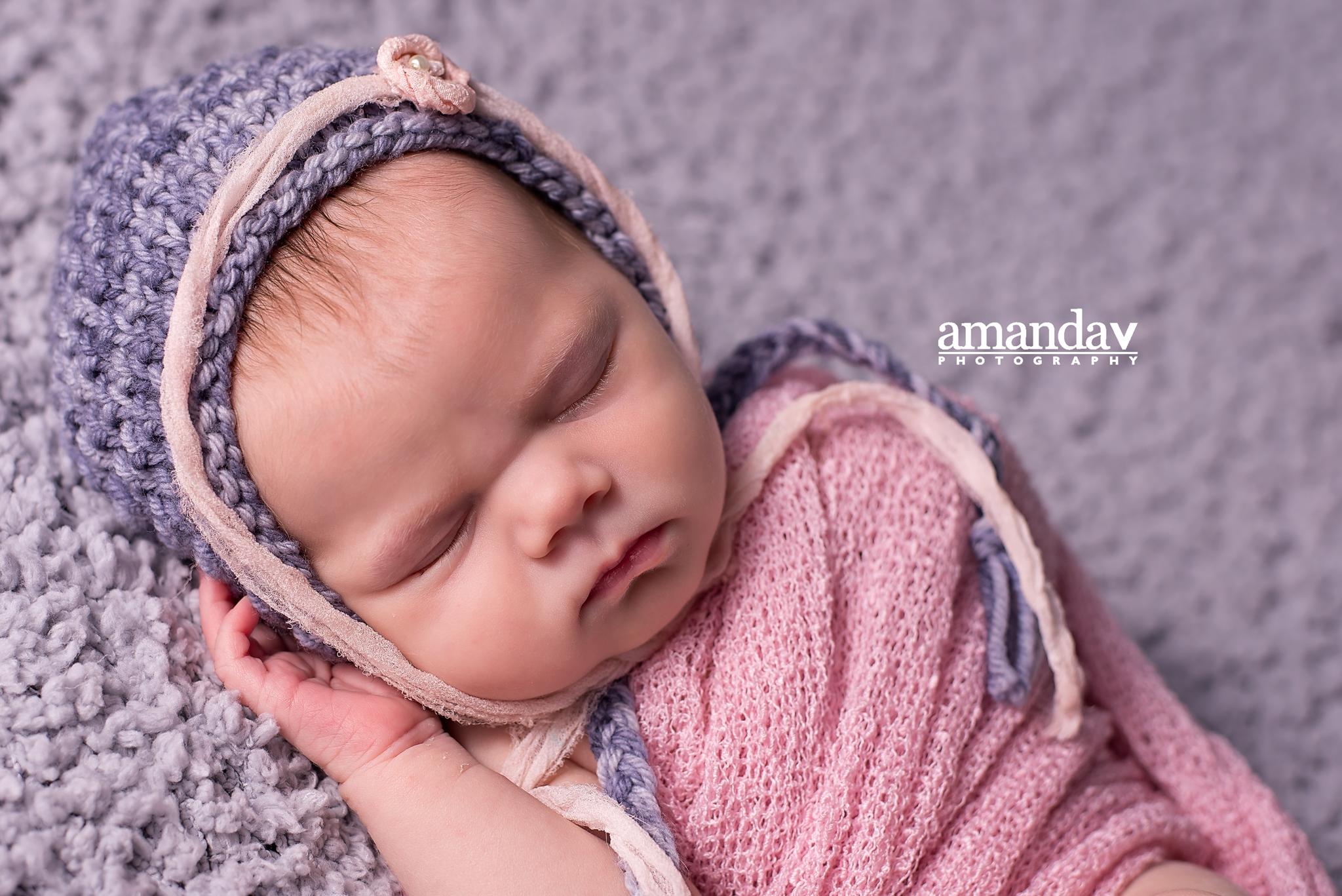 cute newborn in pink and grey