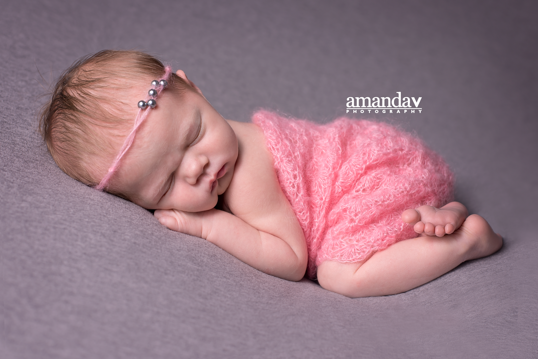 newborn in pink romper
