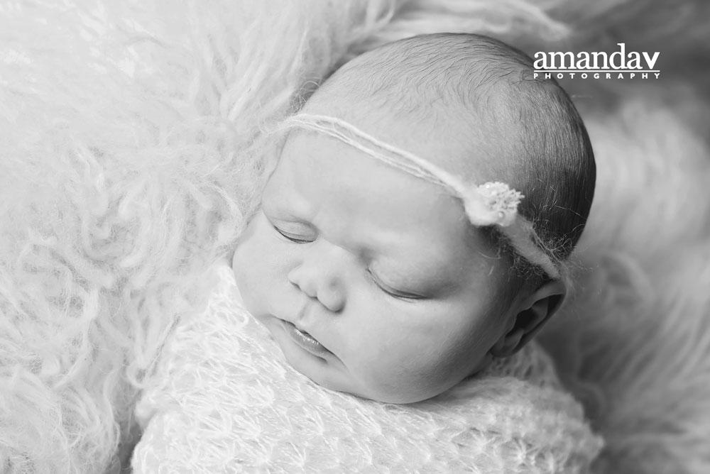 black and white image of newborn girl in Kelowna
