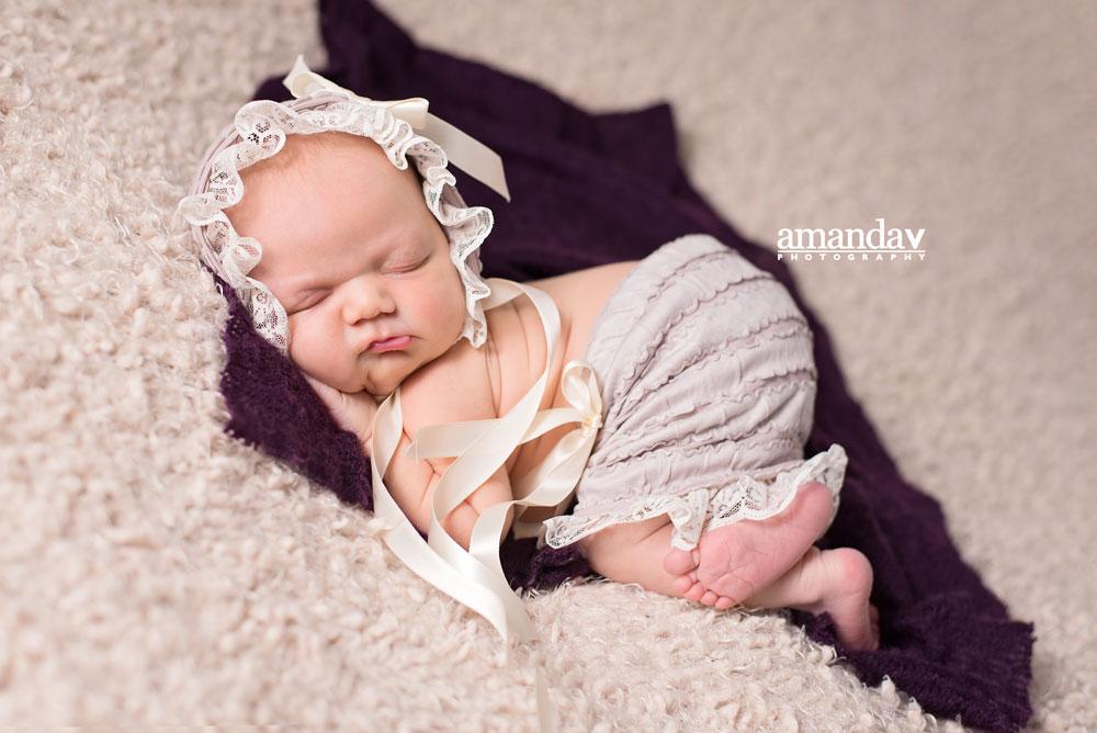 baby girl on beige and purple