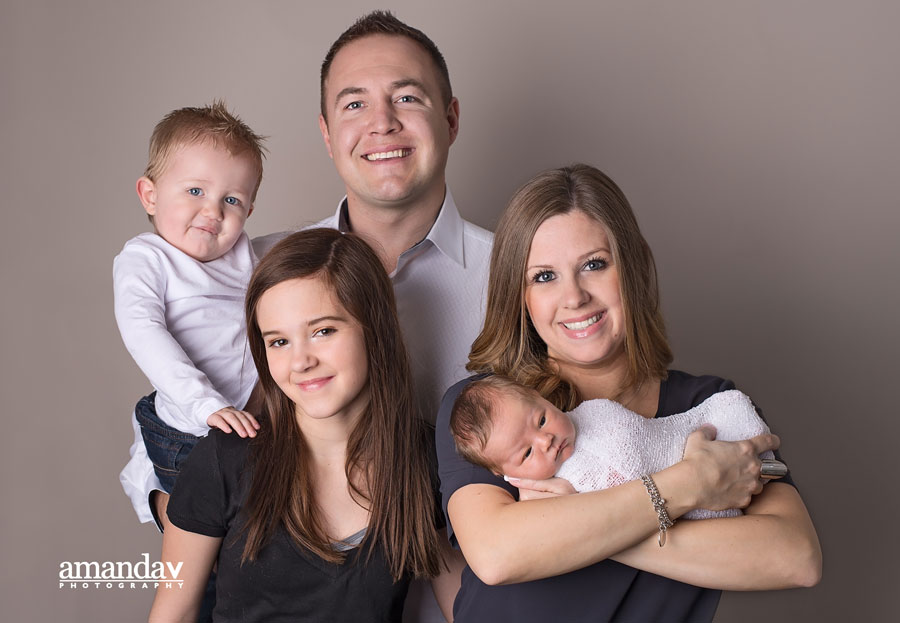 family with newborn image