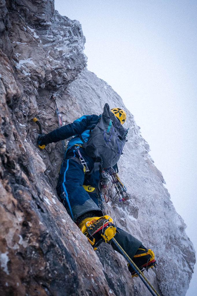 Steve House starts up an exposed pitch on Nad Sitom Glava (Slovenia)in deteriorating weather.