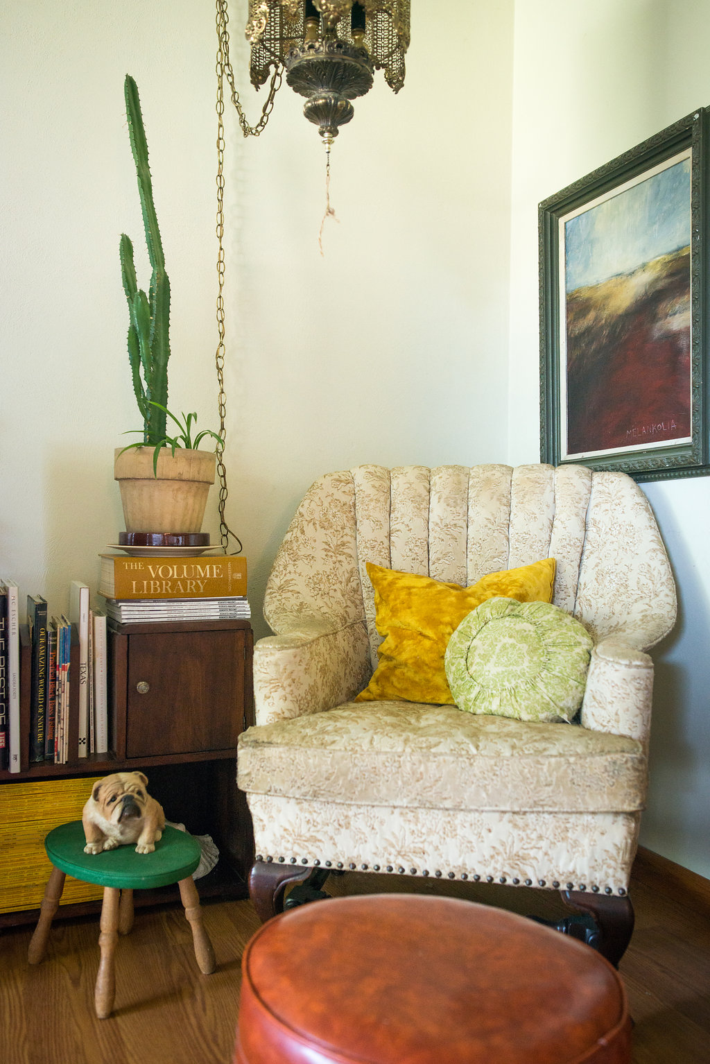The little bulldog was my grandpa's as was the awesome light hanging above. Another Olaf Bisschoff hangs above the chair and my dad's old footstool in front.  Plus the ever-present National Geographic mags.