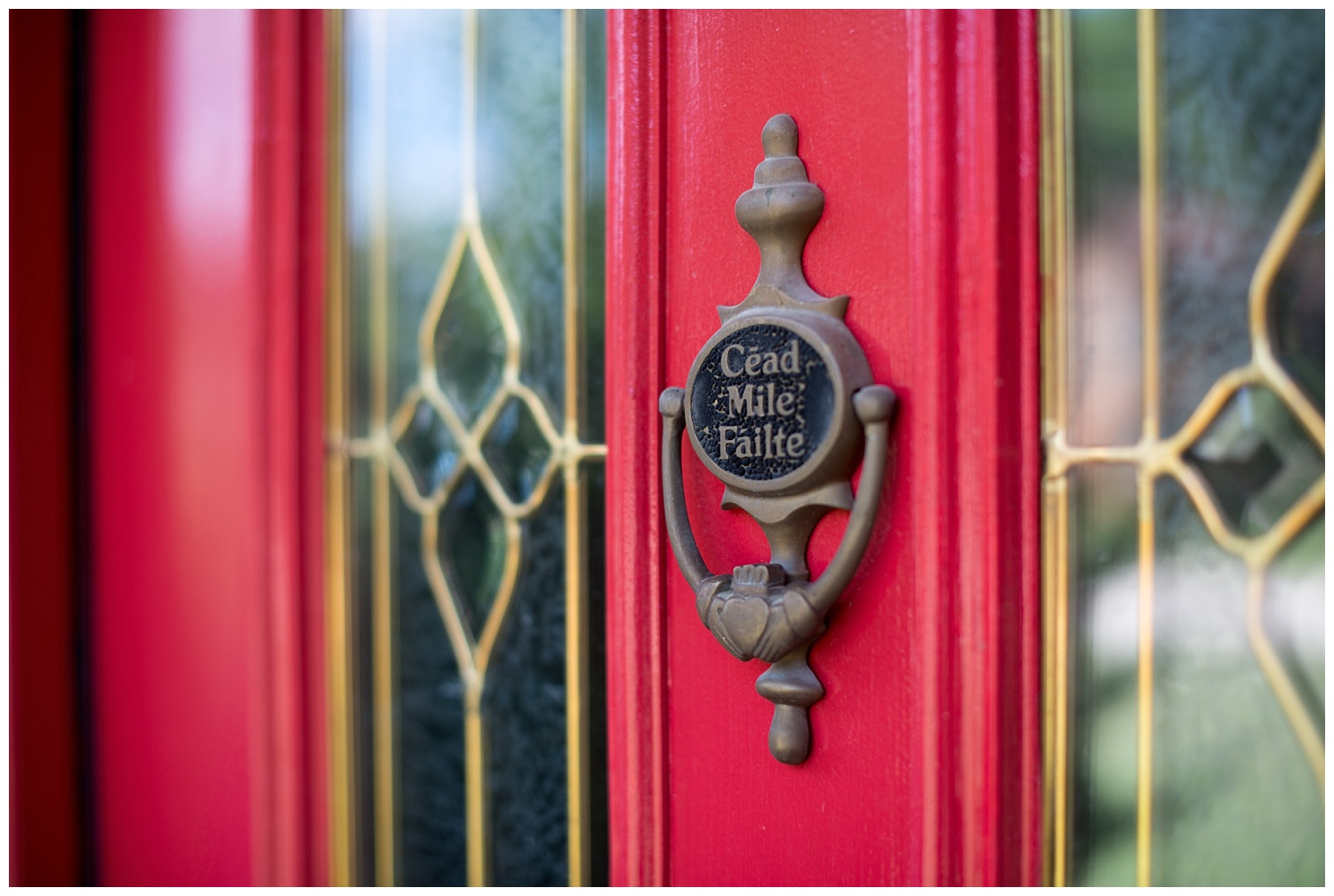 "Even though Catherine grew up in England and Ireland, she didn't put the Claddagh ring - which is a traditional Irish symbol of love, loyalty and friendship - on her front door.  The previous owners of the home were proud of their Irish ancestry and they hung it there.  Catherine did paint the door red.  ""Cead Mille Failte"" means 'one hundred thousand welcomes'."