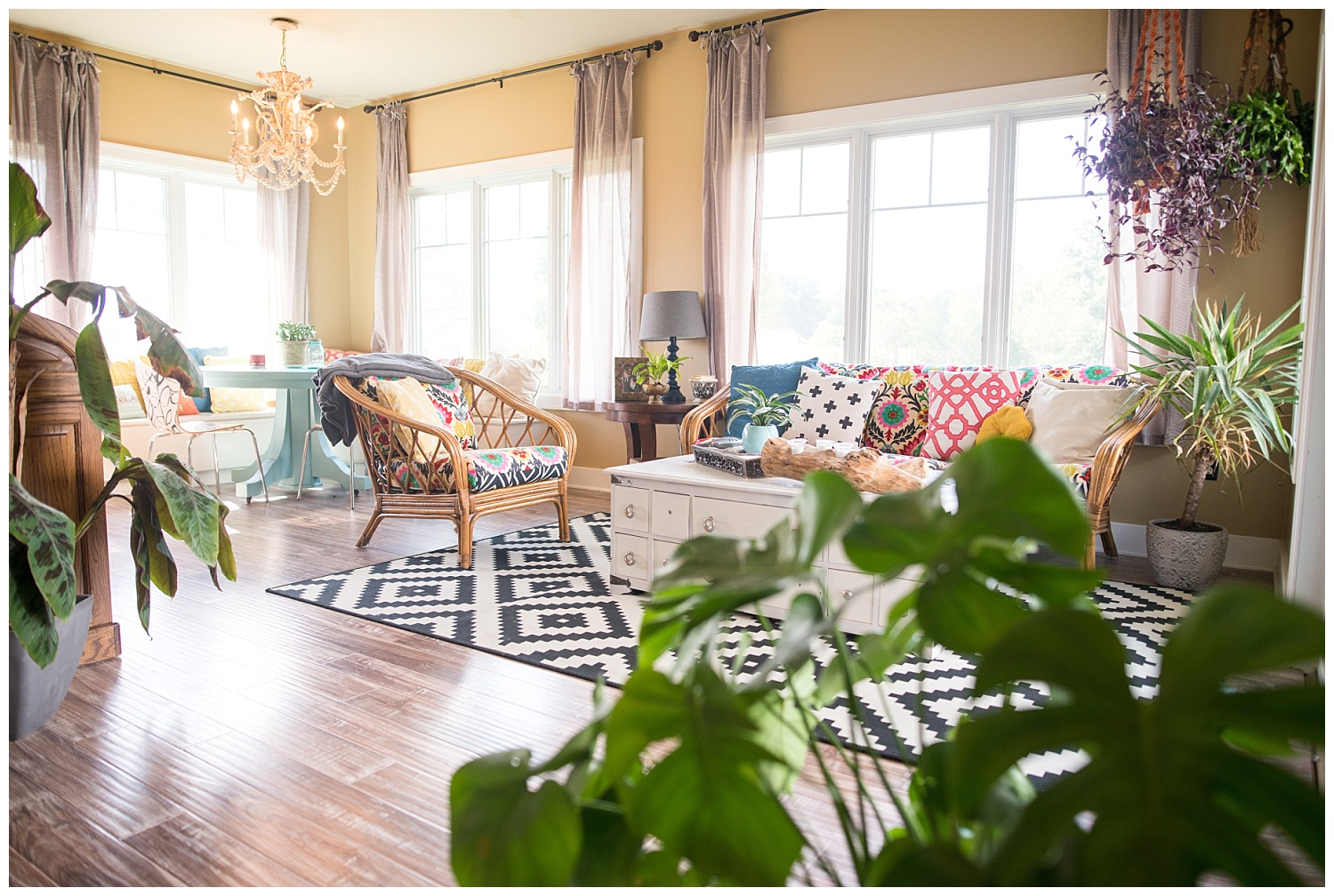 Colorful meets natural meets plants.  How fabulous is this sunroom?  So bright and airy.