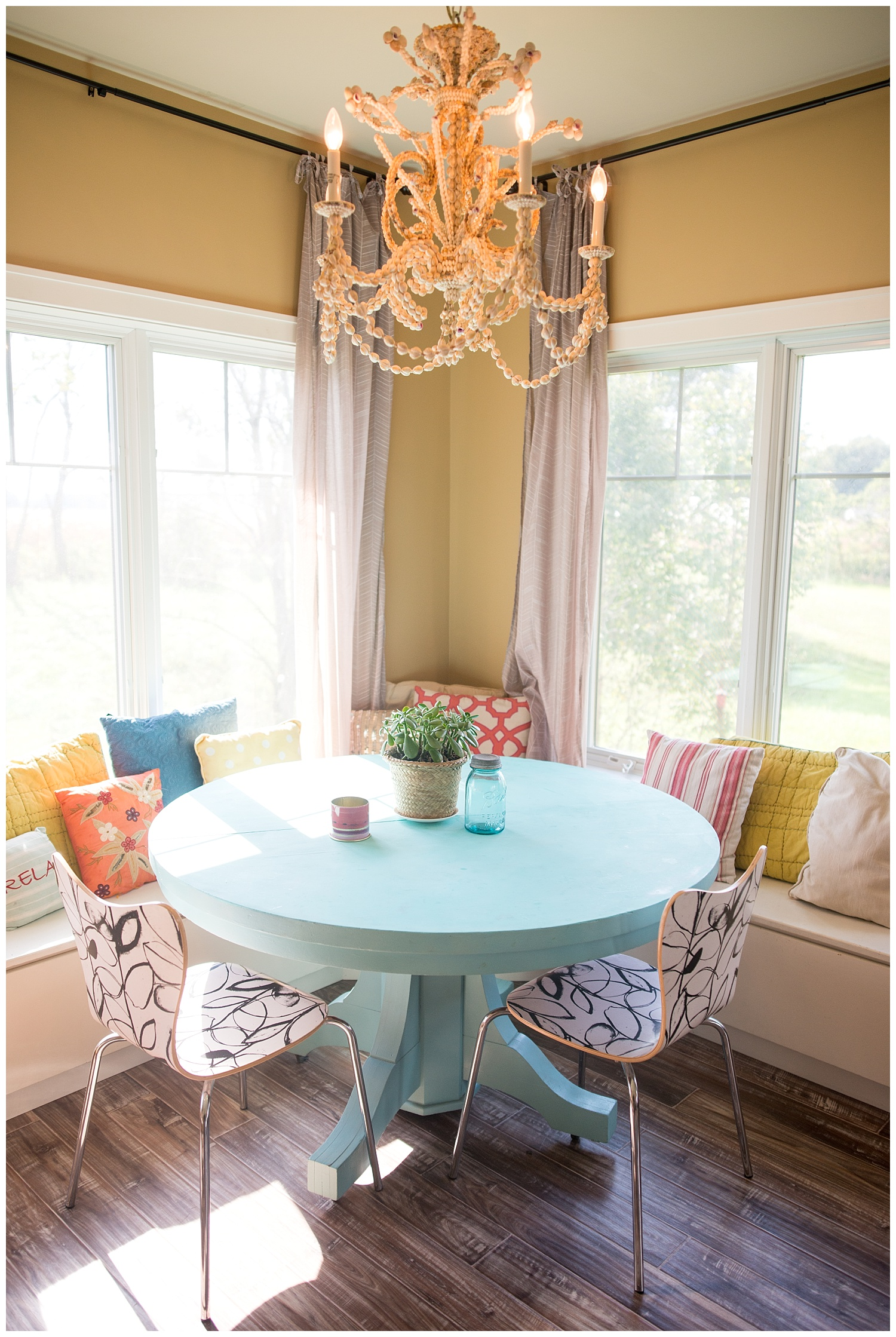 Check out the shell chandelier - it's easy to see why it's one of her favorite things.  The blue table below is one she painted herself.  And when you walk in her home it always smells nice.  On photo shoot day she was burning a few of the soy Illume candles that we carry in the shop.