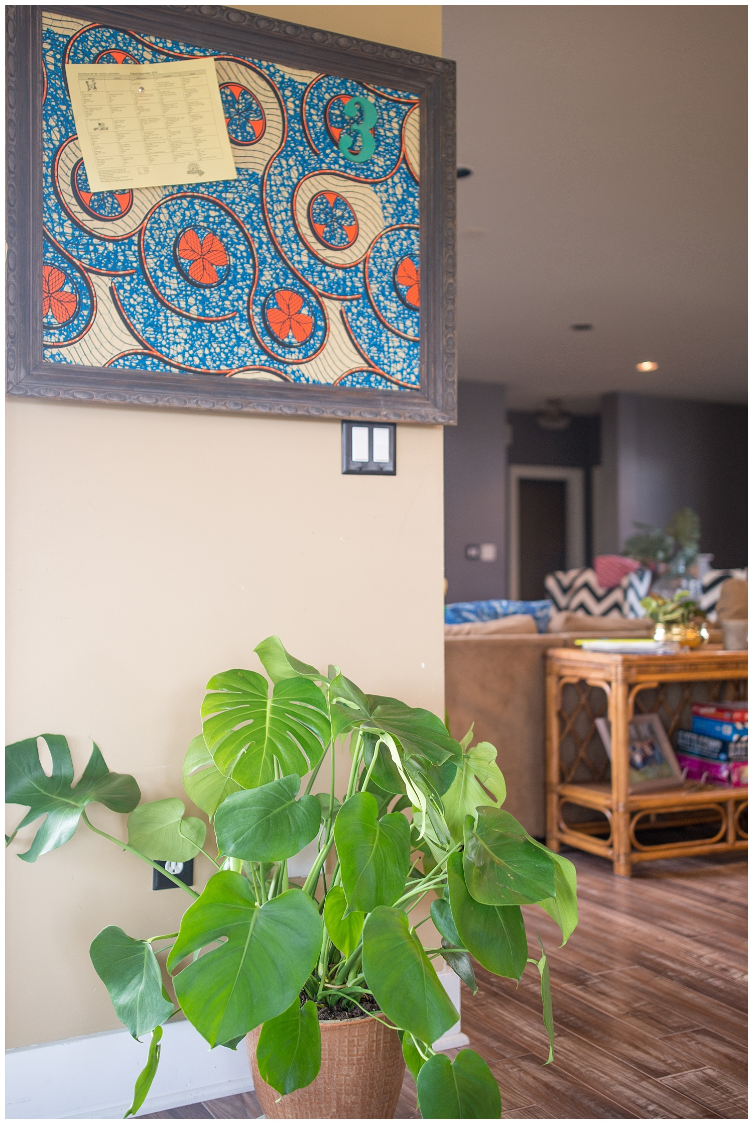 This is an example of a pinboard that you can find in both Fresh Digs and her online shop.  This particular one was made with African wax print fabric that I brought back from South Africa. This view is from the sunroom looking into her wide open living room.
