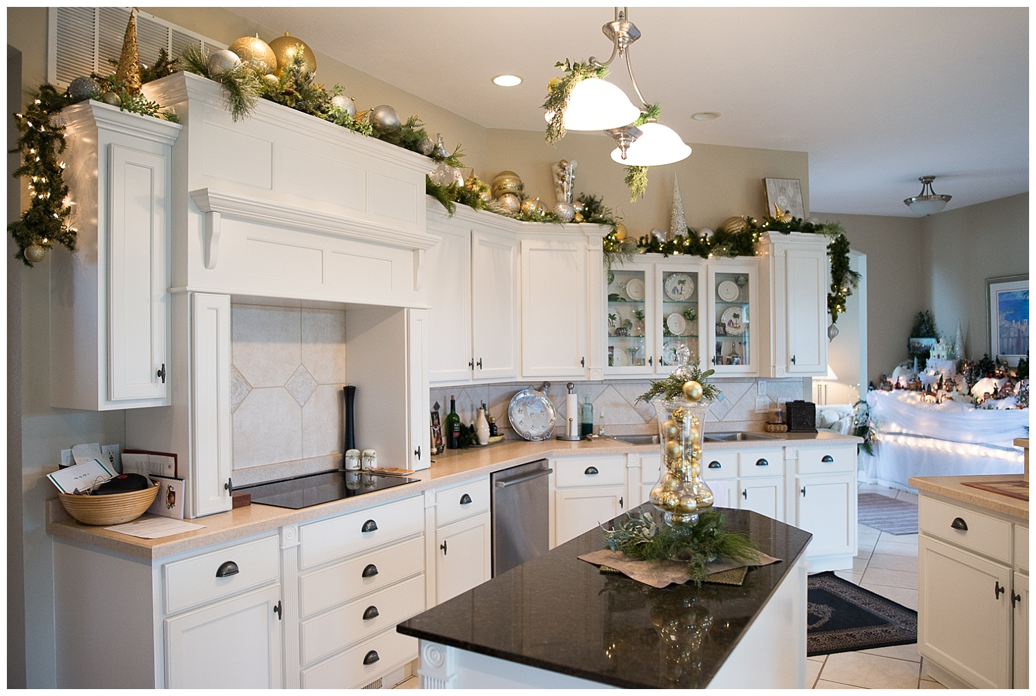 And garland.  Something as simple as garland with lights and ornaments packs quite a punch.  She changes out the layout above the cabinets in her kitchen four times a year.  When it's not Christmas, Easter or Halloween palm trees reside in this space.
