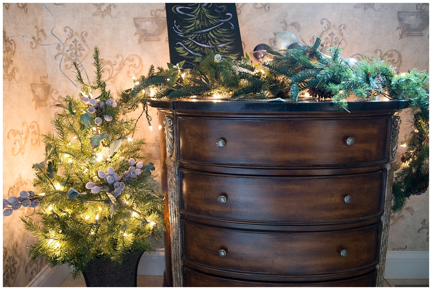 Even the bathroom has Christmas cheer.  She was given the  Jan VonBokel  Christmas tree painting and worked it into her dresser decor.