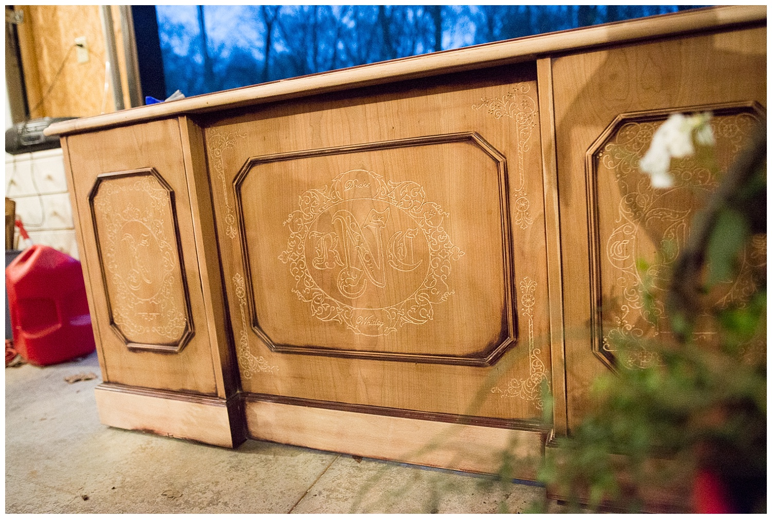 Chandra showed us this piece in the garage. Carving meaning into this executive desk is Ray's current project and he's busy carving the family tree into the sides of it.