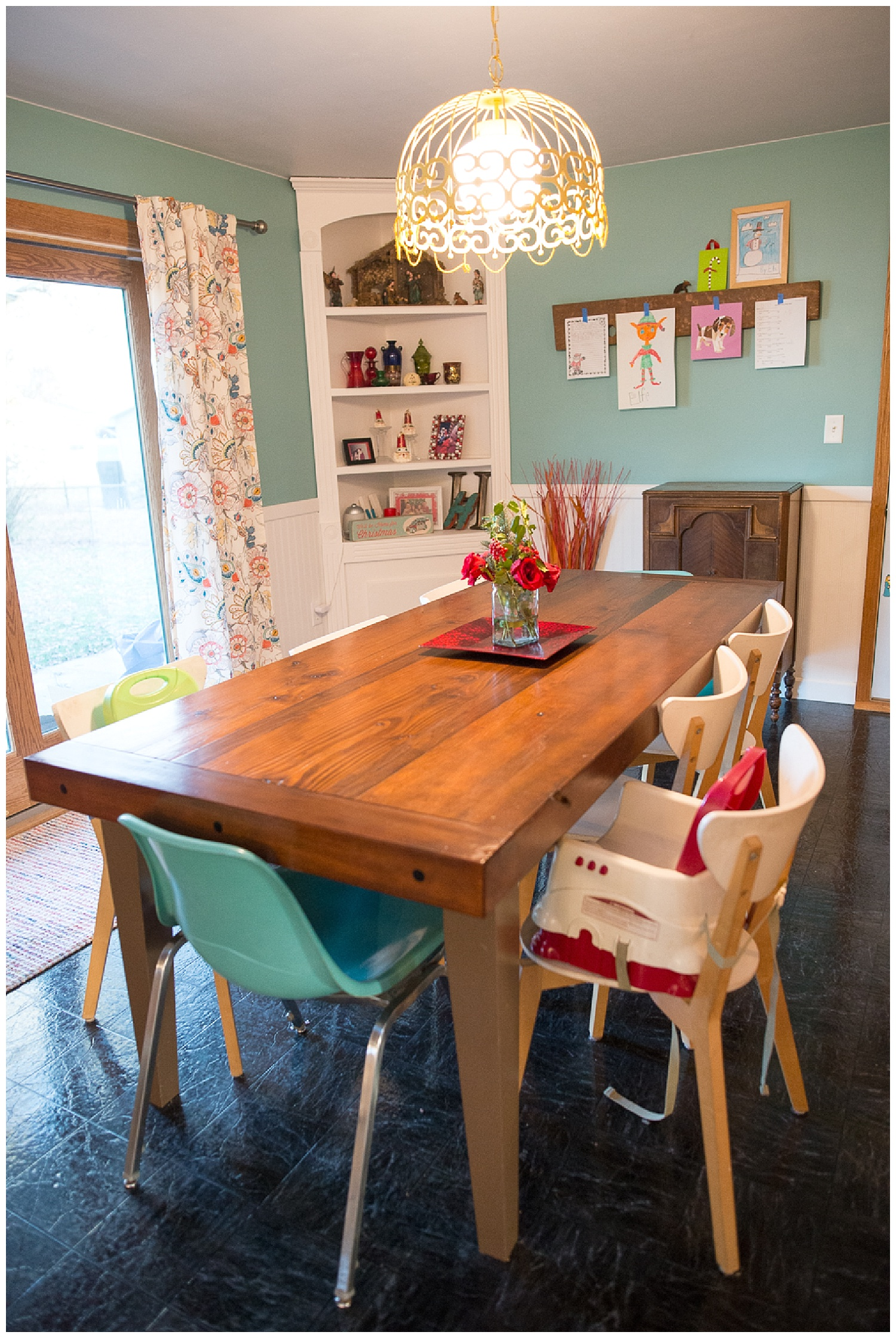 Their dining table was one of Kevin's brother,  Aaron's , first builds and the wood to build it was sourced from an old Equity storage building.  Kevin saw them tearing it down, asked for the wood and he and his dad grabbed the beams.  The teal chairs came from Fresh Digs and the white ones from Ikea.