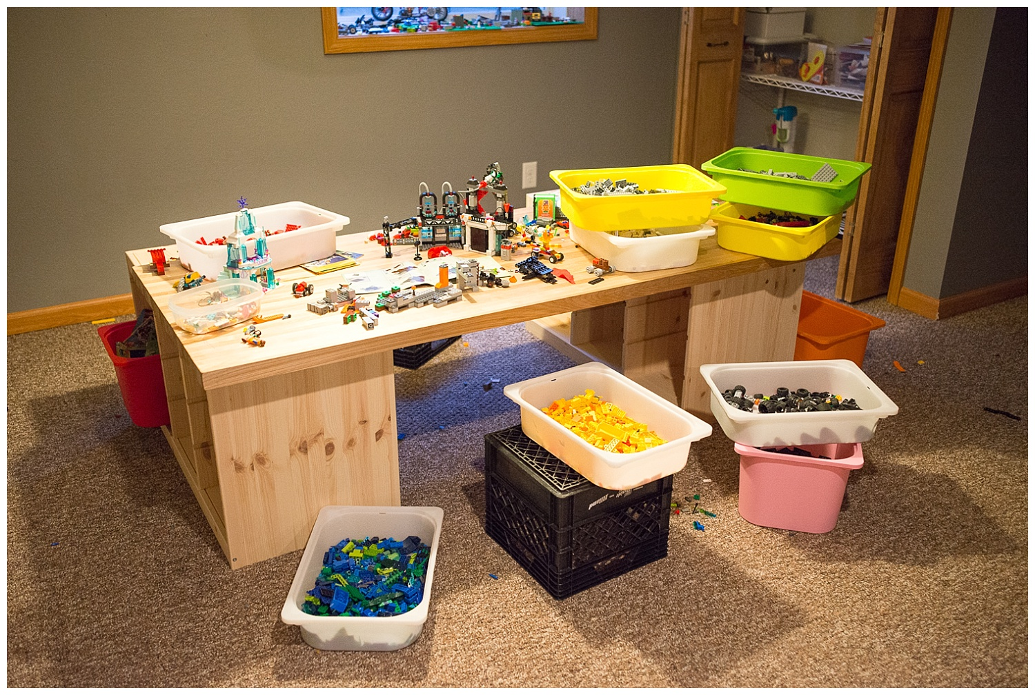 Just outside of the boys' room is a Lego table complete with bins separating the different colors.  Kevin said doing this helped reignite their love for Lego.  The bins slide into the Ikea base and he found a top to unify it at, you guessed it, the John Boos Outlet.