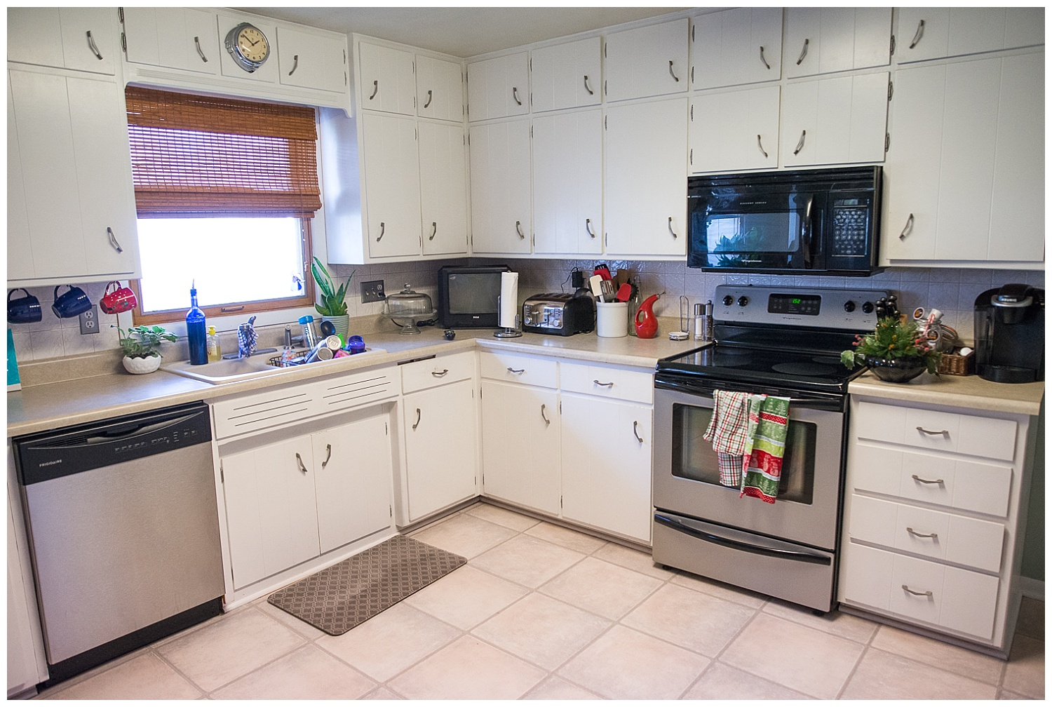 This gleaming kitchen is thanks to spotless white painted kitchen cupboards. And they are thanks to a team of family members pitching in to get them painted in the week before the Stortzums moved in.