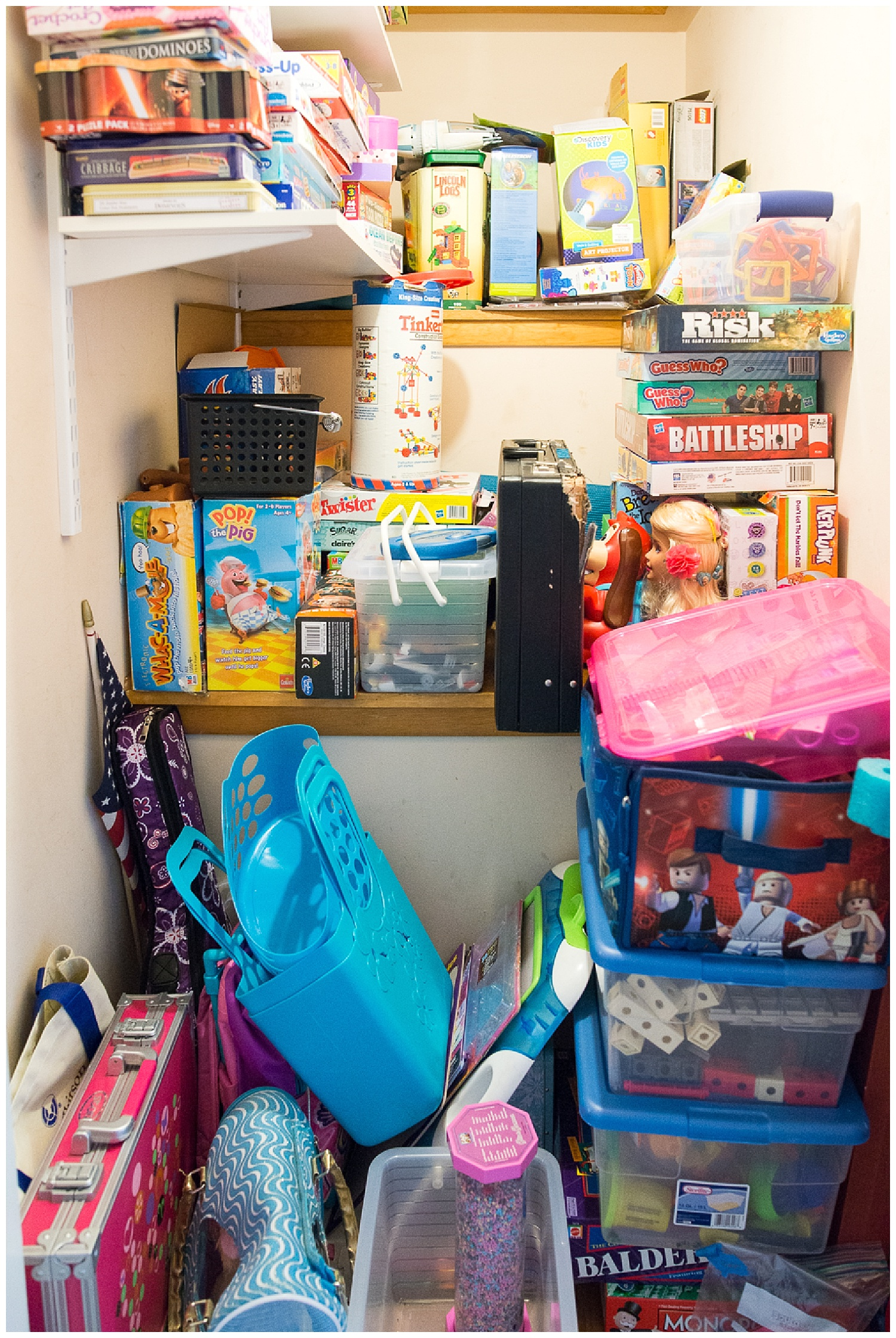 I love peeking into people's closets. This stairwell leading up to the attic is the perfect spot for games, games and more games.