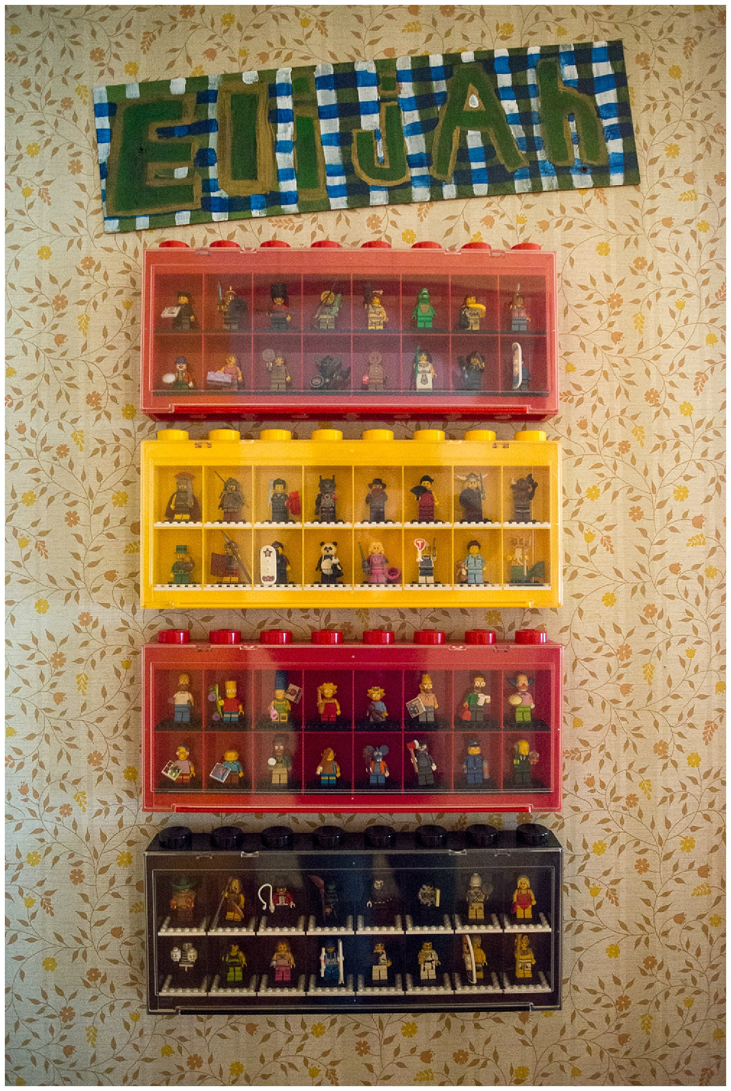 Eli's room.  I wish they still made these Lego man boxes.  And that wallpaper.