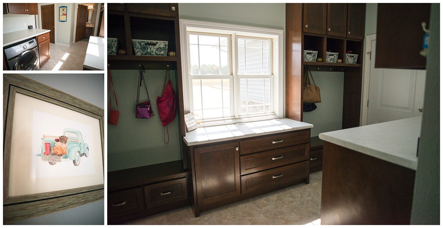 Just off the kitchen is the mudroom and half-bath. Again with loads of custom cabinets, this workhorse of a room looks very neat and tidy. Hanging on the wall is a framed Whitney Ruger watercolor print.