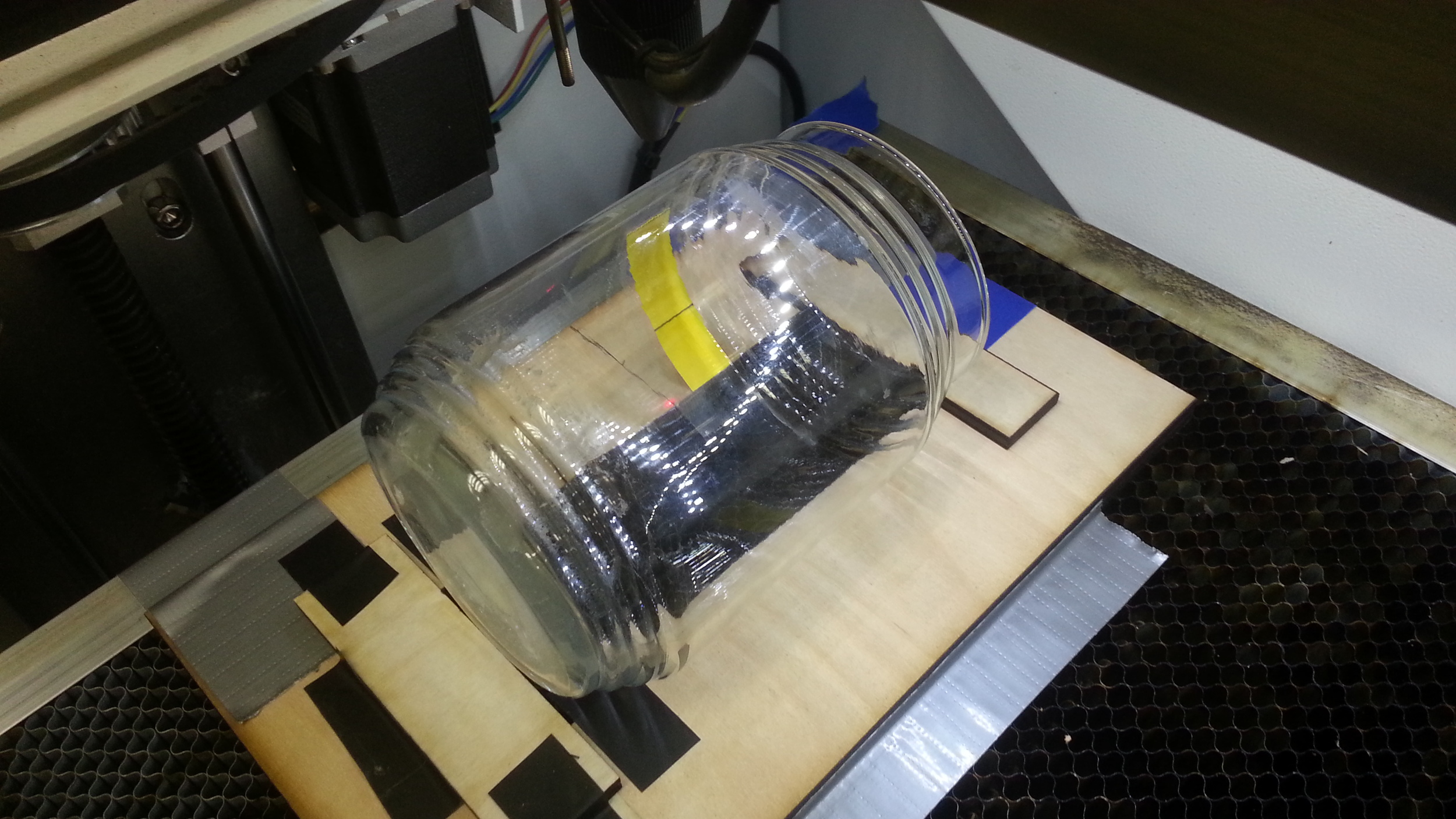 Process for using a laser cutter to etch glass jars for a wedding at Edgewater Workbench in Chicago