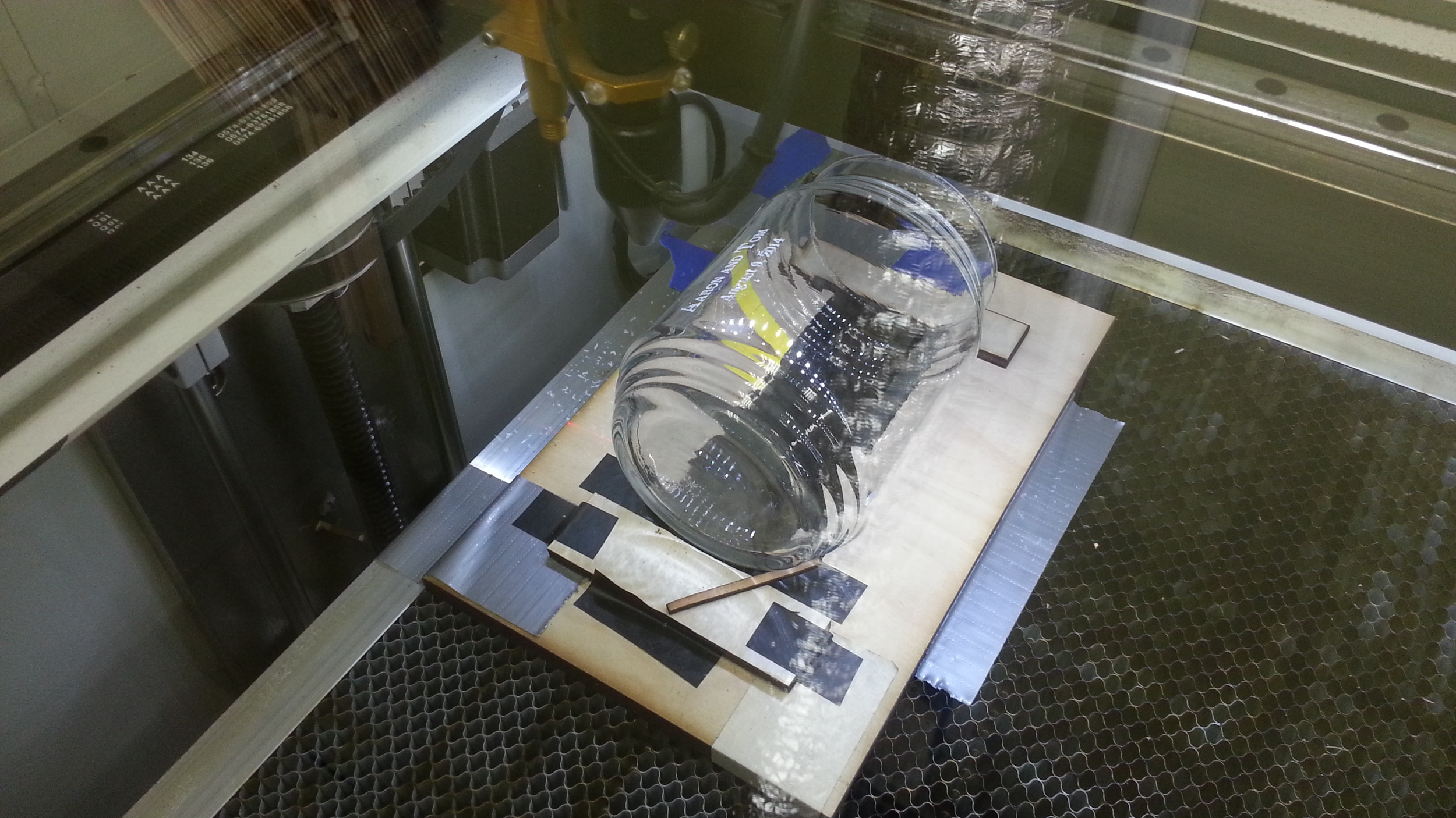 Process for using a laser cutter to etch glass jars for a wedding at Edgewater Workbench