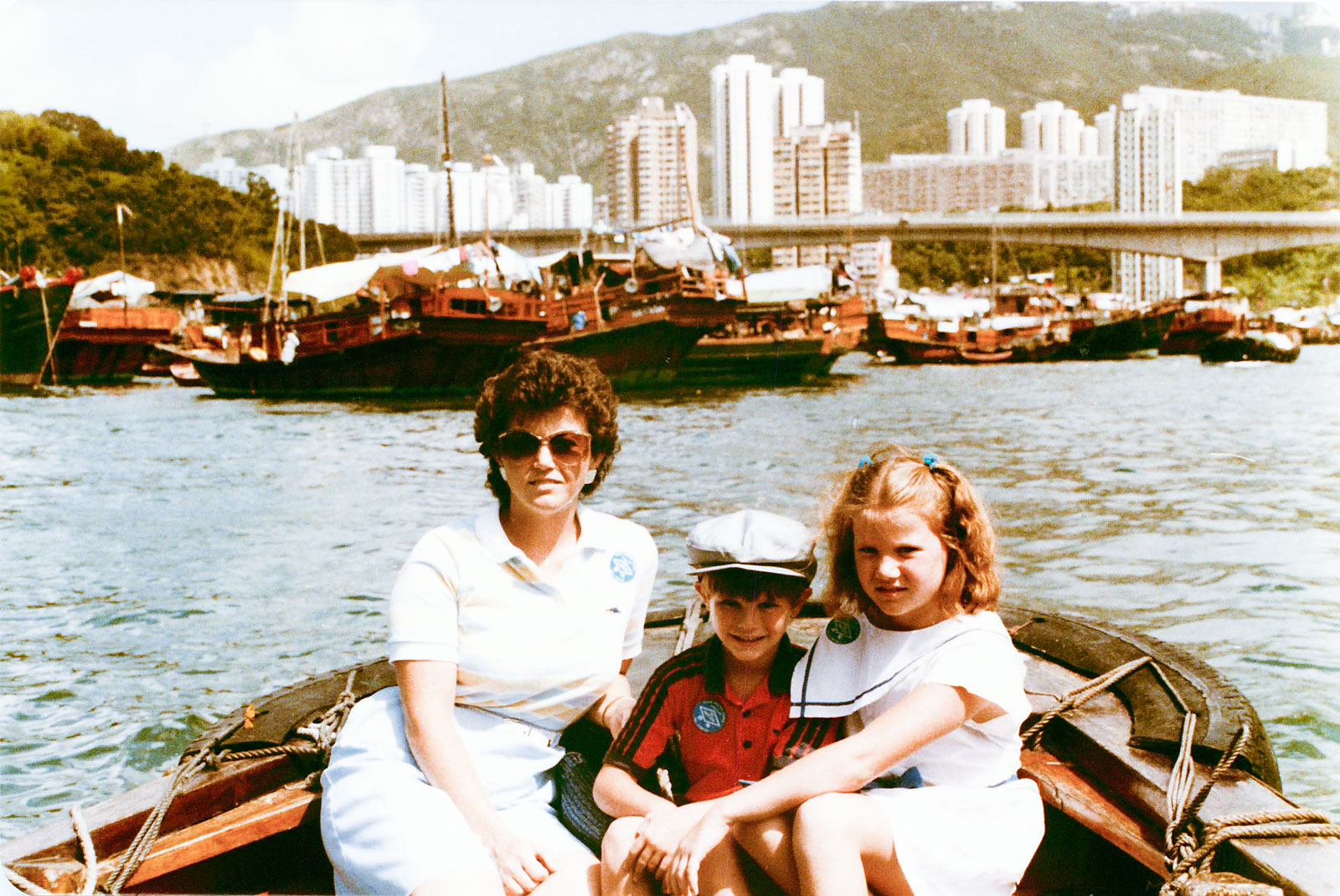 Didn't you want to see me growing up? How about my sailor outfit? My mom's awesome hair/sunglasses/culottes? My brother's sweet adidas shirt? Just your typical white people in Hong Kong in the 80s. And yea, this does prove that I've always had RBF.