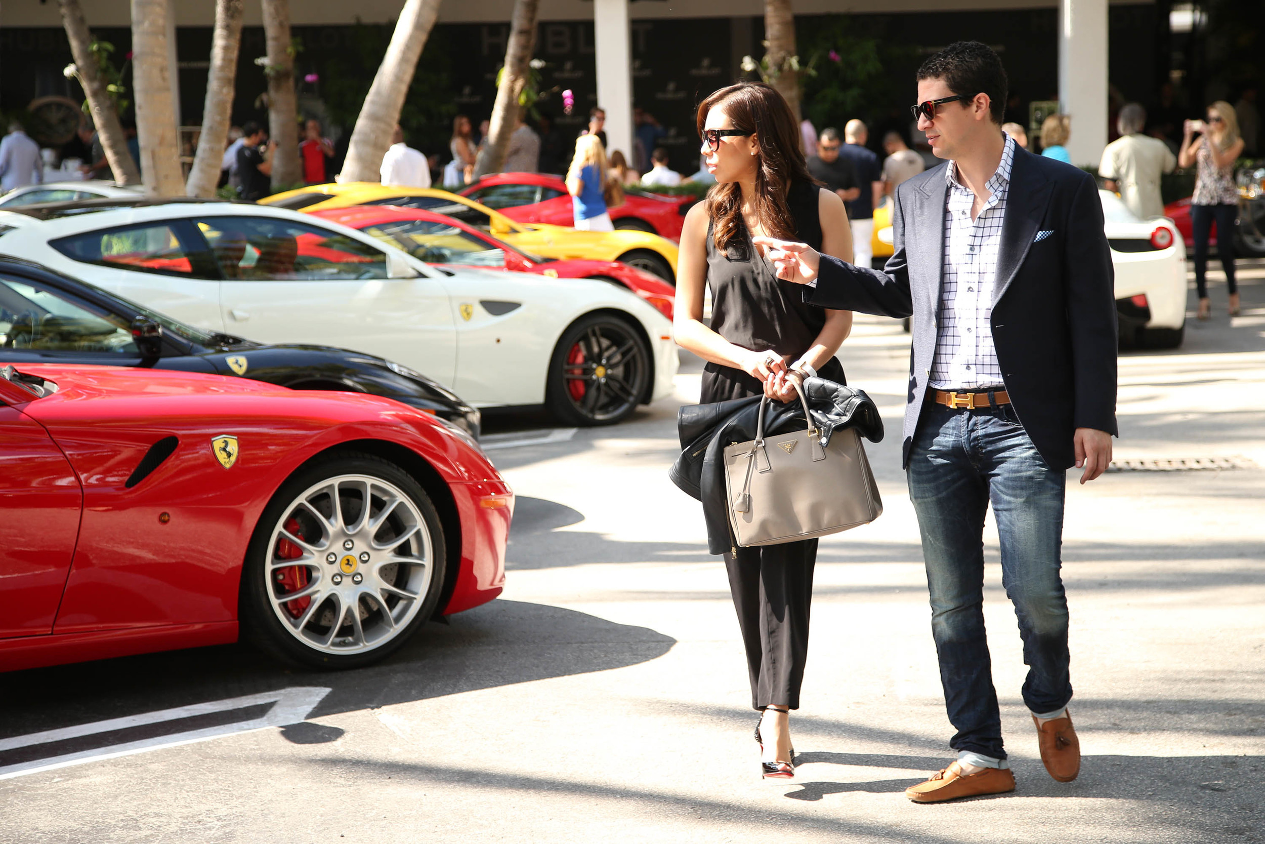 Event Attendees Taking a Look at a Ferrari.