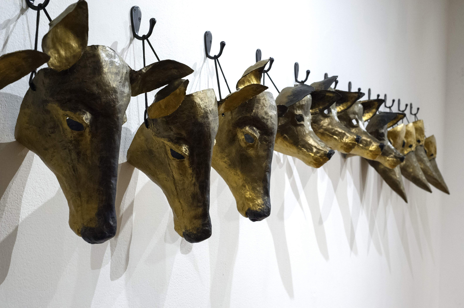 Visitors were encouraged to wear these animal masks while viewing sculpture