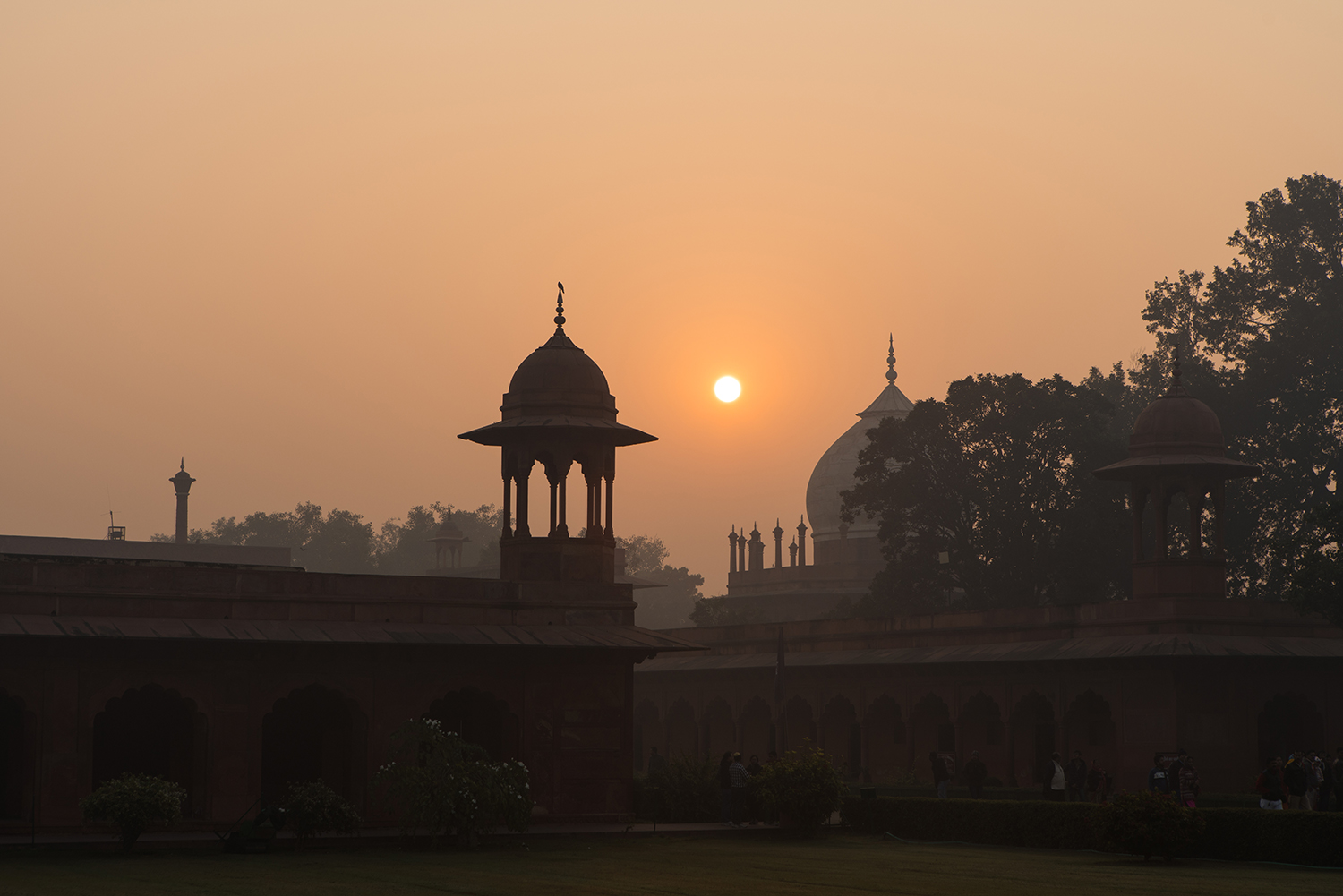 The sun rising over the Taj Mahal