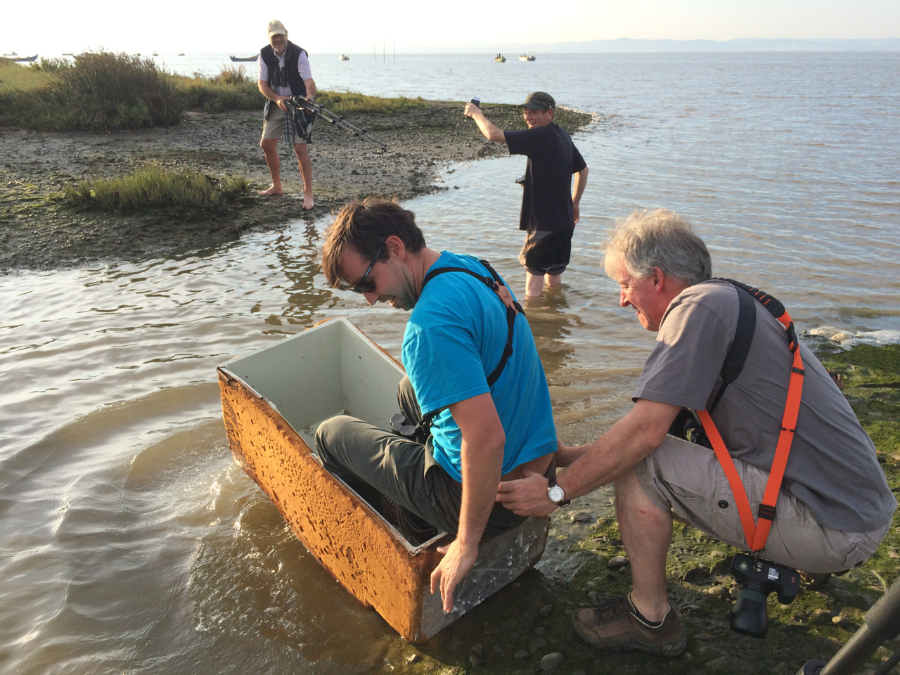 Some of the birders in my group trying to crossing a deep channel in an ancient cooler...that also had a GIGANTIC hairy spider lurking the debris in the bottom.