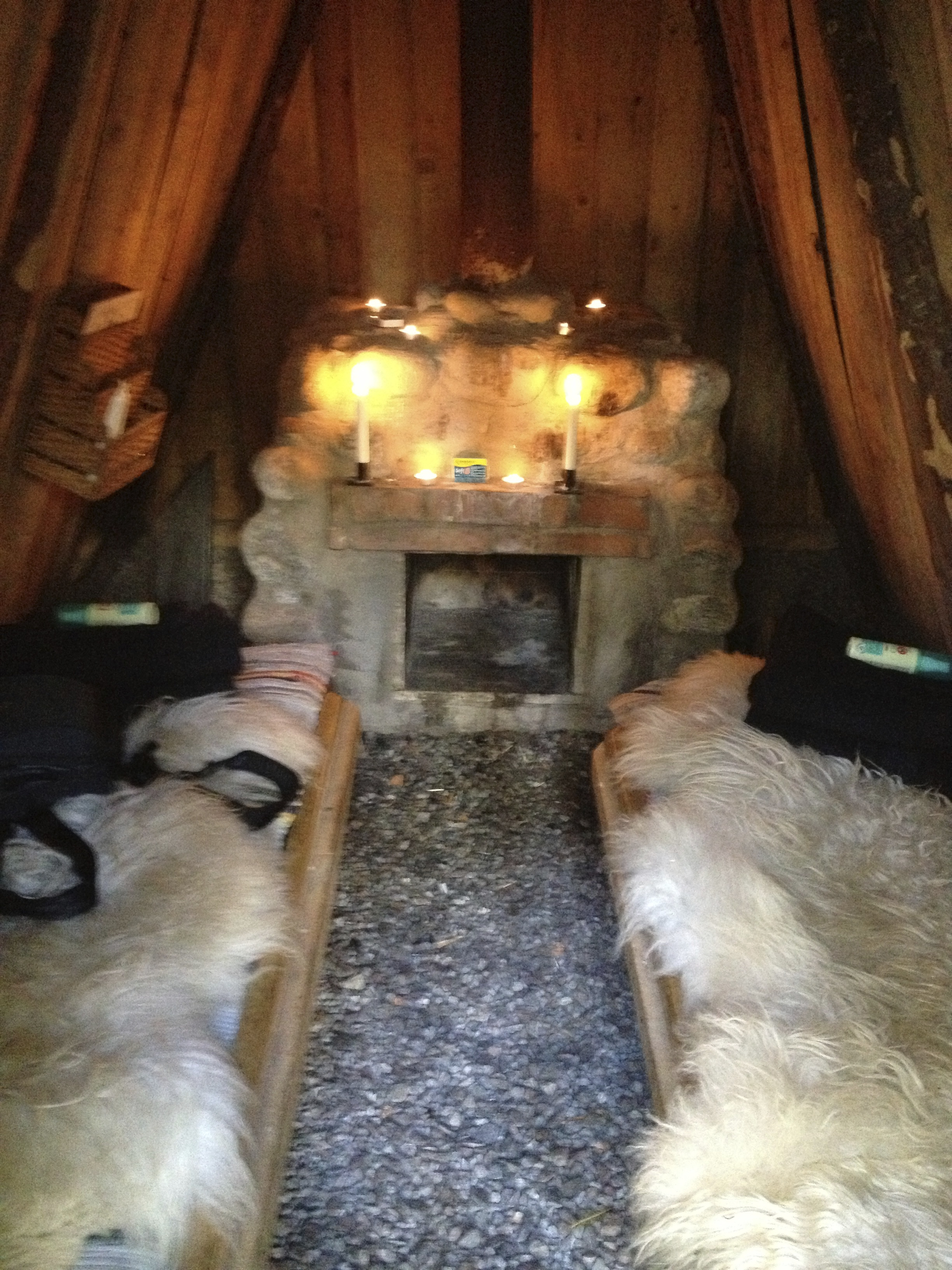 The inside of my hut complete with wood burning stove and wooden planks with sheepskin to sleep on. We also added some padding and a sleeping bag for good measure.