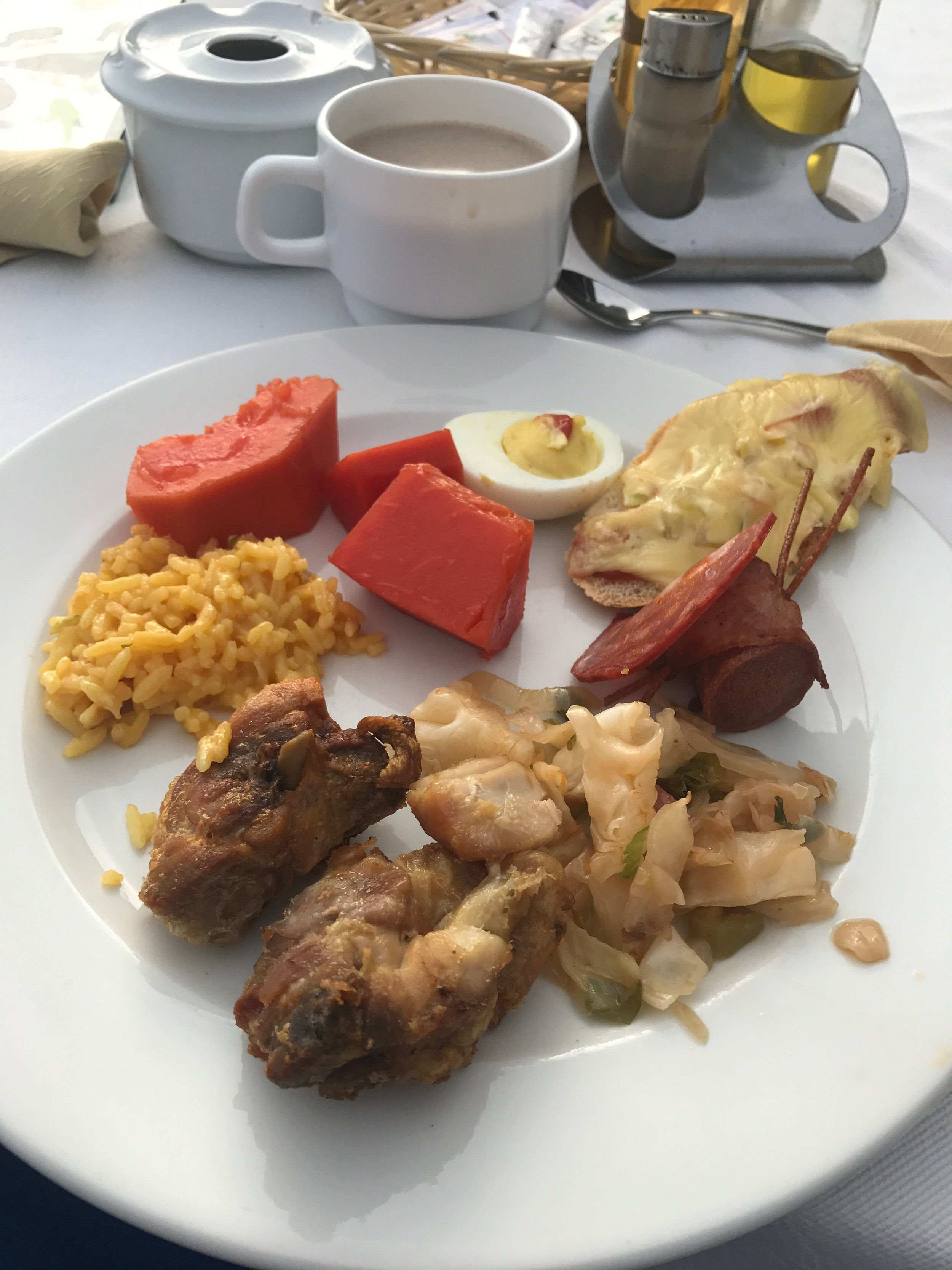 Sampling of the breakfast buffet at my Havana hotel: papaya, cheesy rice, friend chicken, suateed cabbage, hot dog wrapped in pepperoni, deviled egg, baguette with melted cheese. There all kinds of breads and roll to choose from as well.