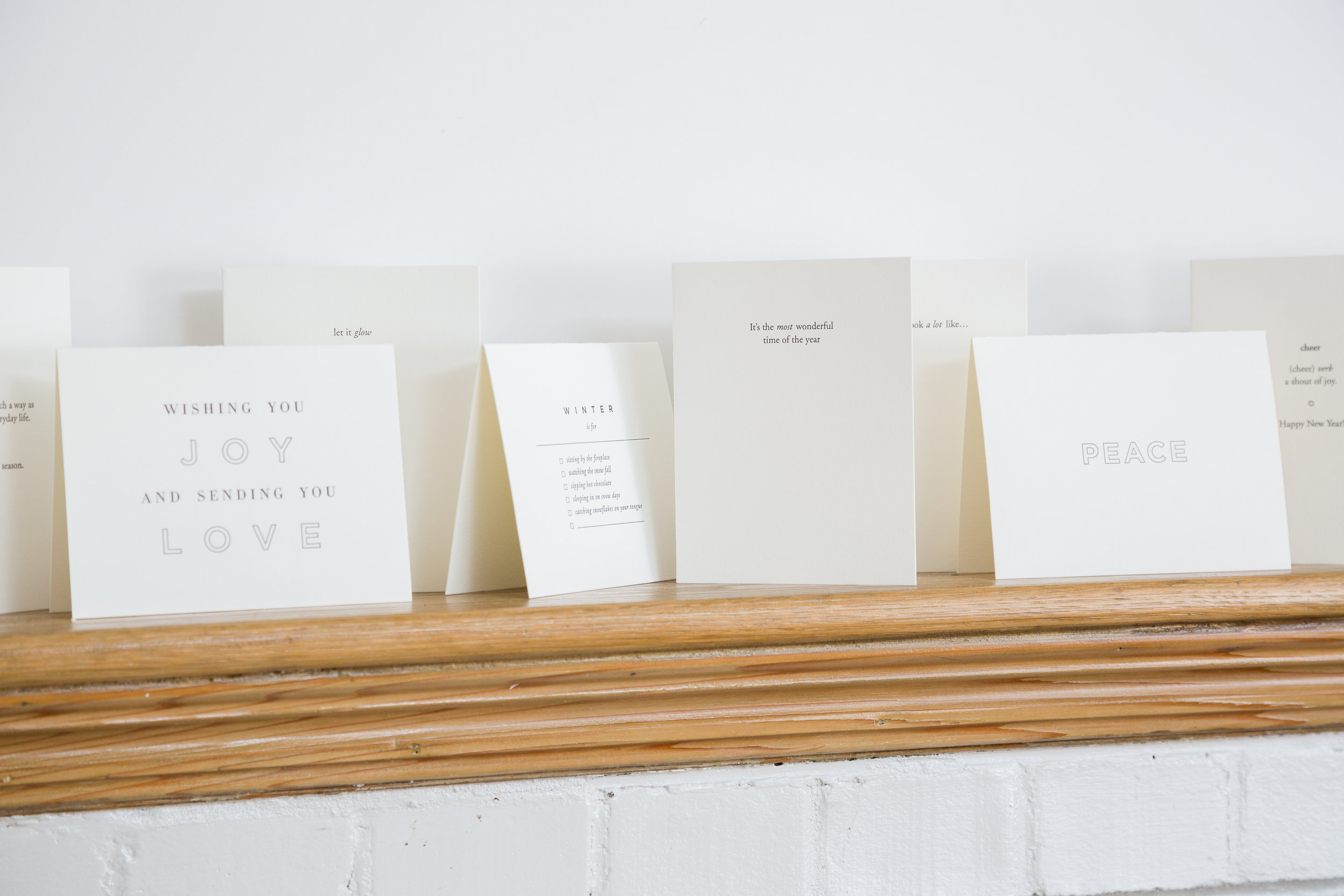 Well have minimal and meaningfully designed holiday cards that will certainly win you a spot on your friends' mantles.