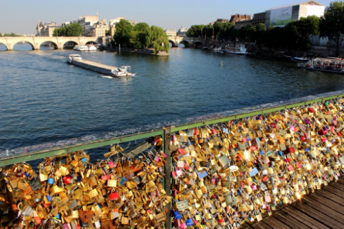 Gross gross gross! Love locks on the Pont des Arts last summer. Now most parts of the bridge are covered with gratified plywood...classy.