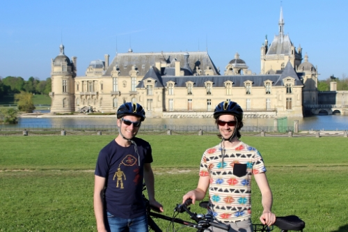 Two happy cyclists at the Chateau of Chantilly. A little small, but you know...
