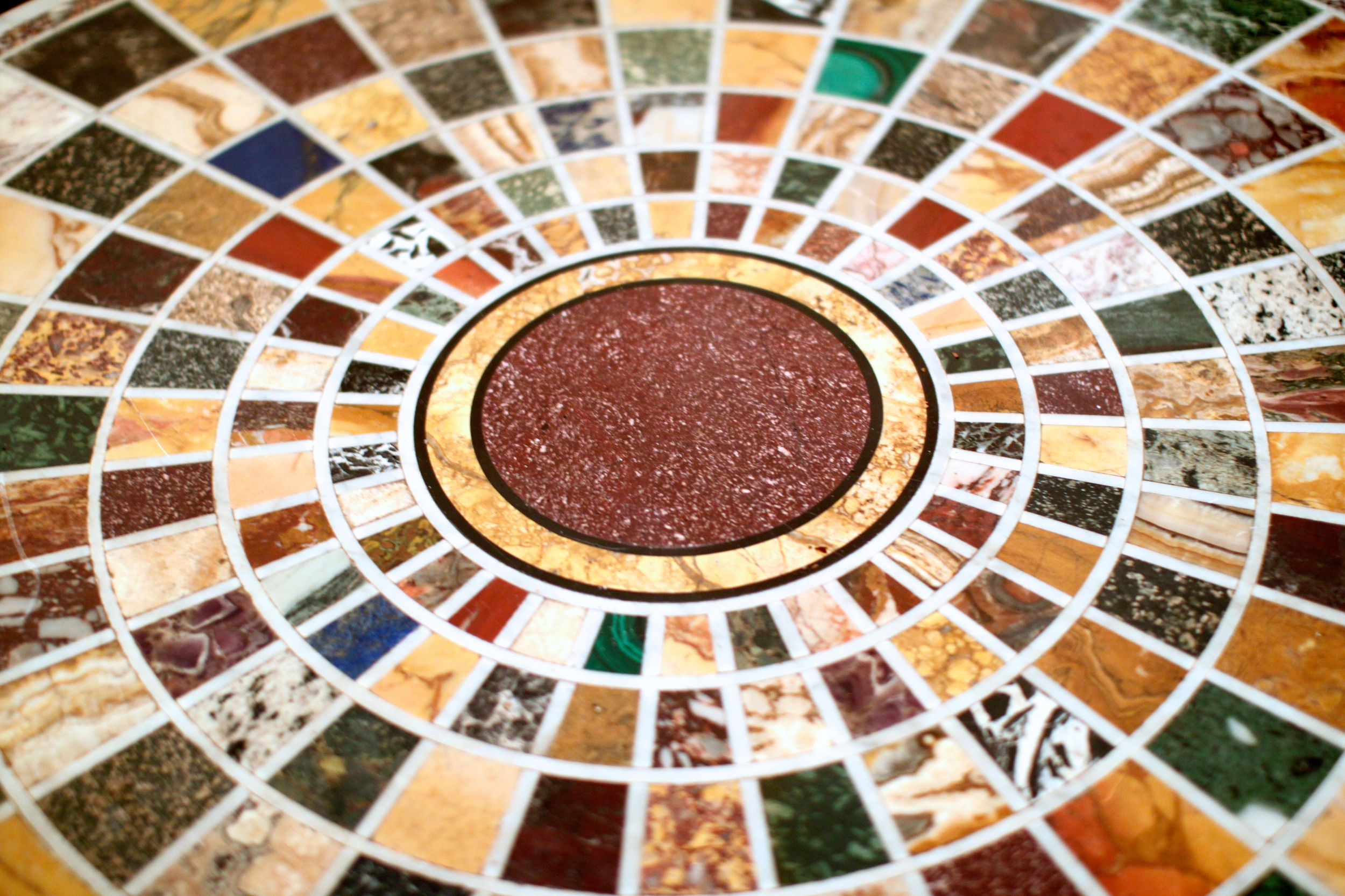Custom intarsia table with variety of ancient marble and stone