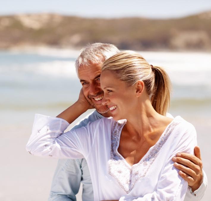 25-iStock_000010234273Small-happy-mature-couple-enjoying-beach.jpg